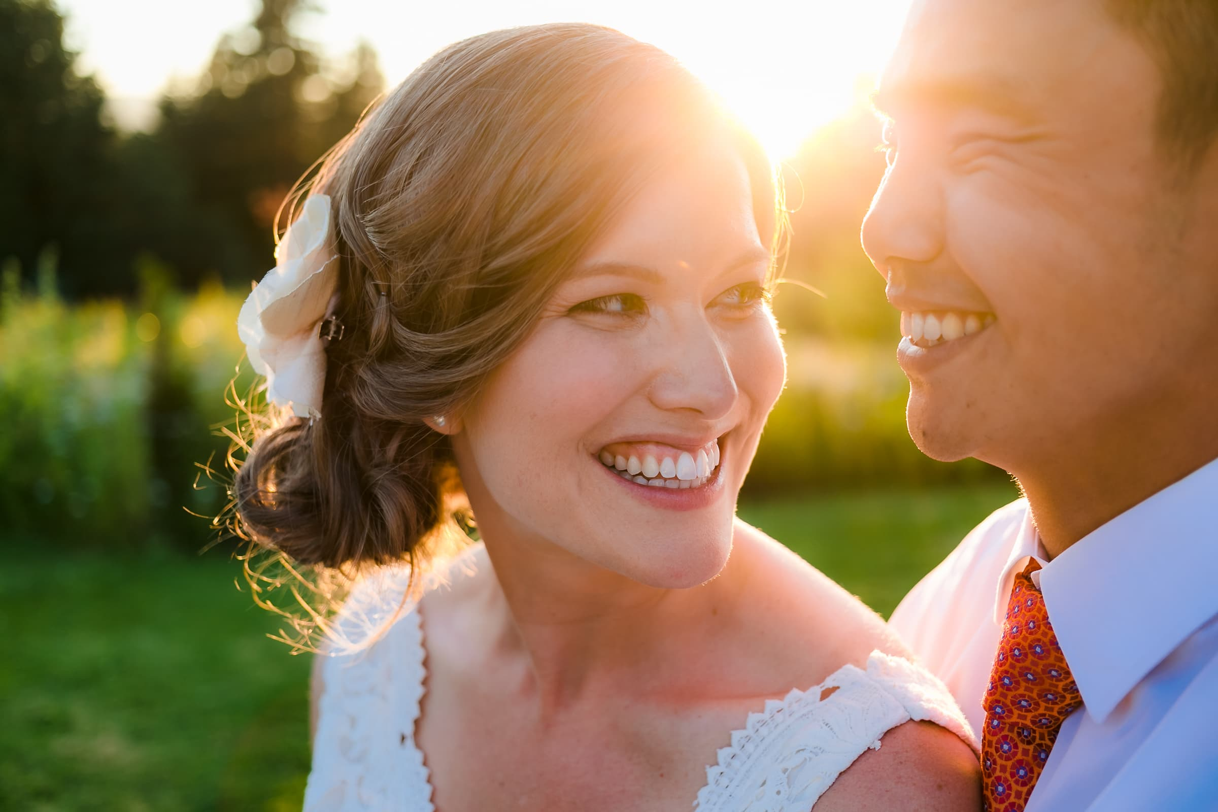 Bride and groom with warm sunlight bursting behind them during their Mt Hood Organic Farms sunset