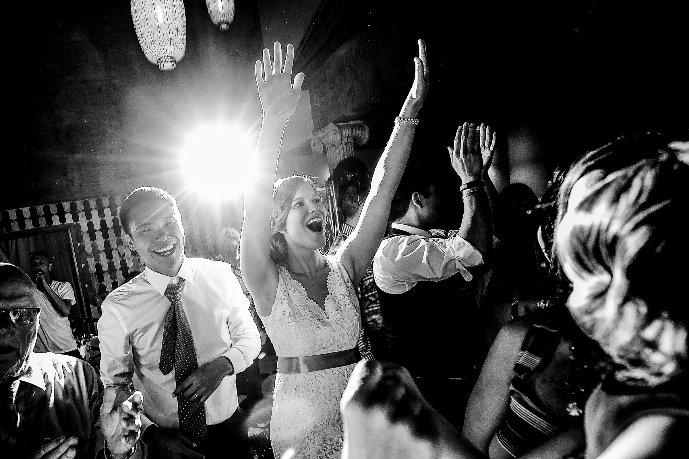 Bride and groom dancing together with energetic family and friends during their Mt Hood Organic Farms wedding reception