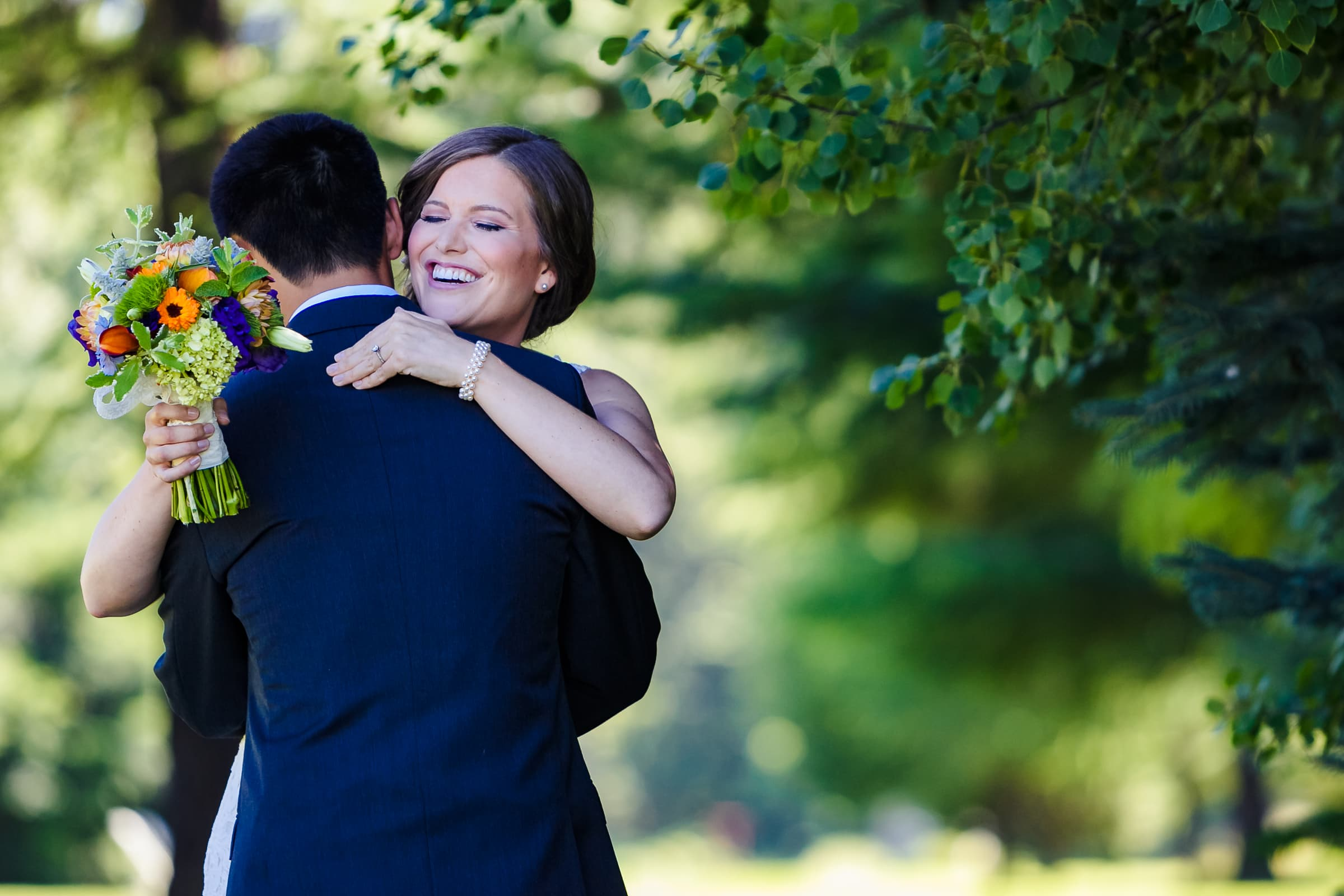Bride and groom hugging each other for the first time before their Mt Hood Organic Farms Wedding ceremony