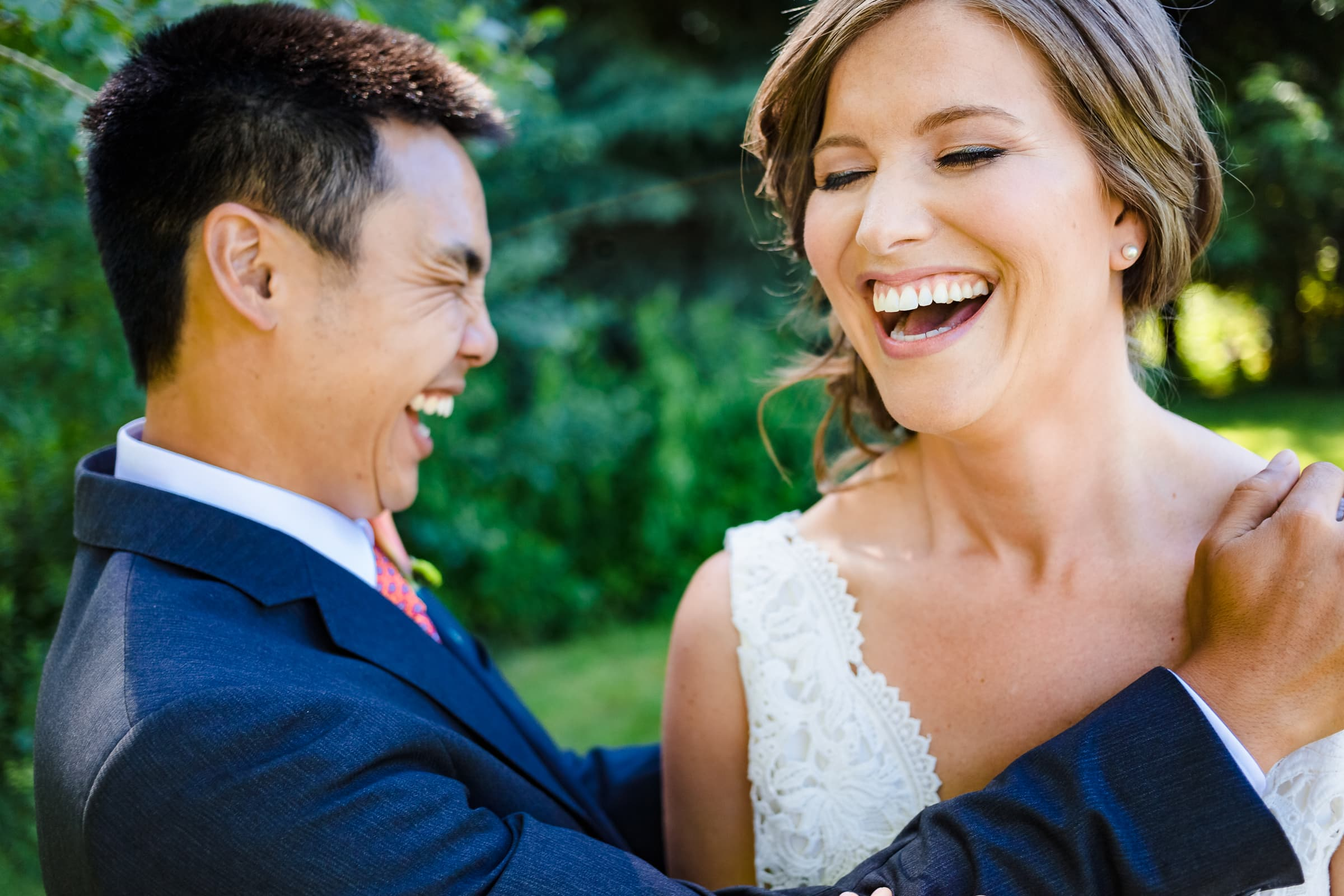 Bride and groom laughing together before their Mt Hood Organic Farms Wedding ceremony