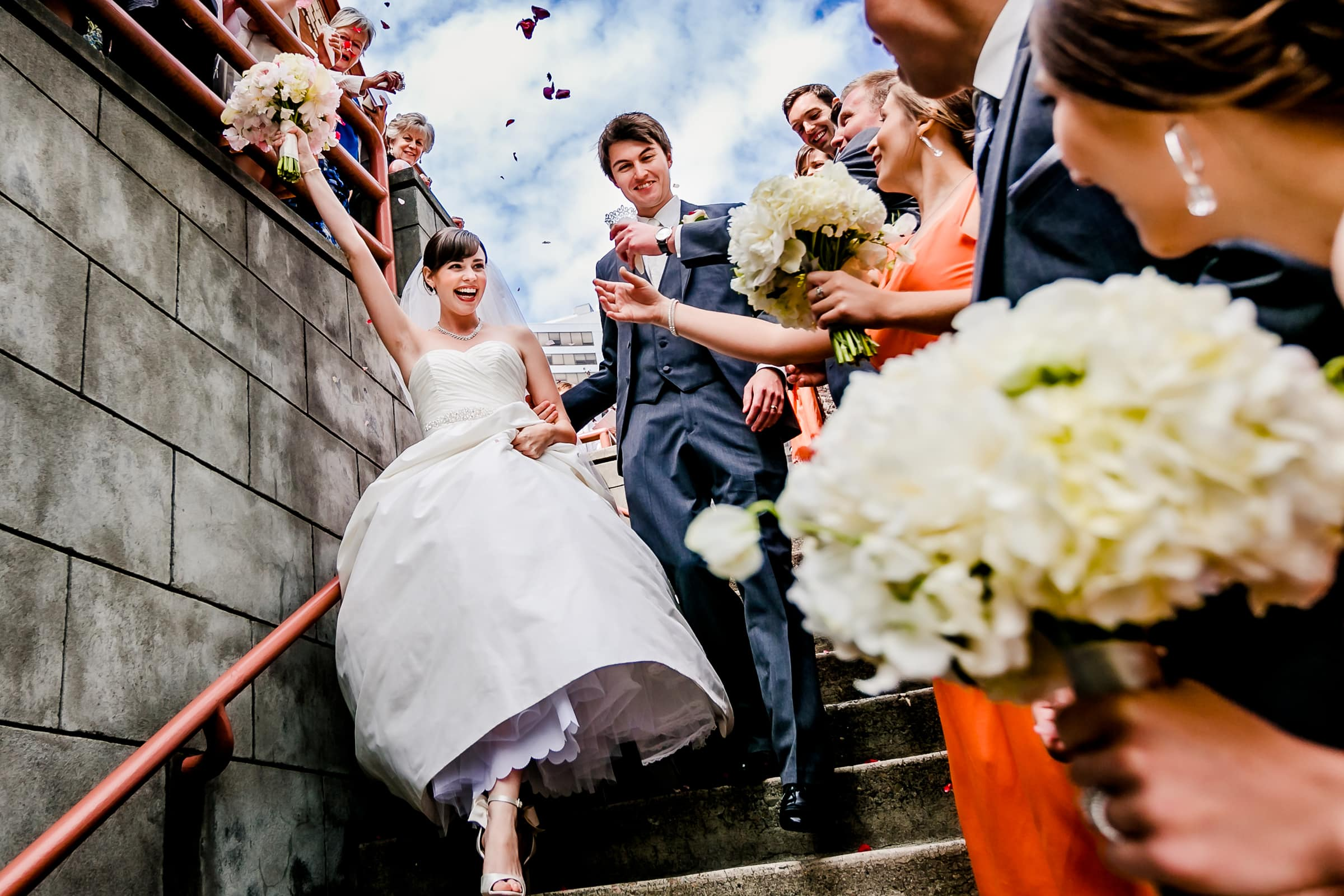 An exciting photo of bride and groom exiting out of the First Presbyterian Church in Portland while heading to their Waverley Country Club wedding