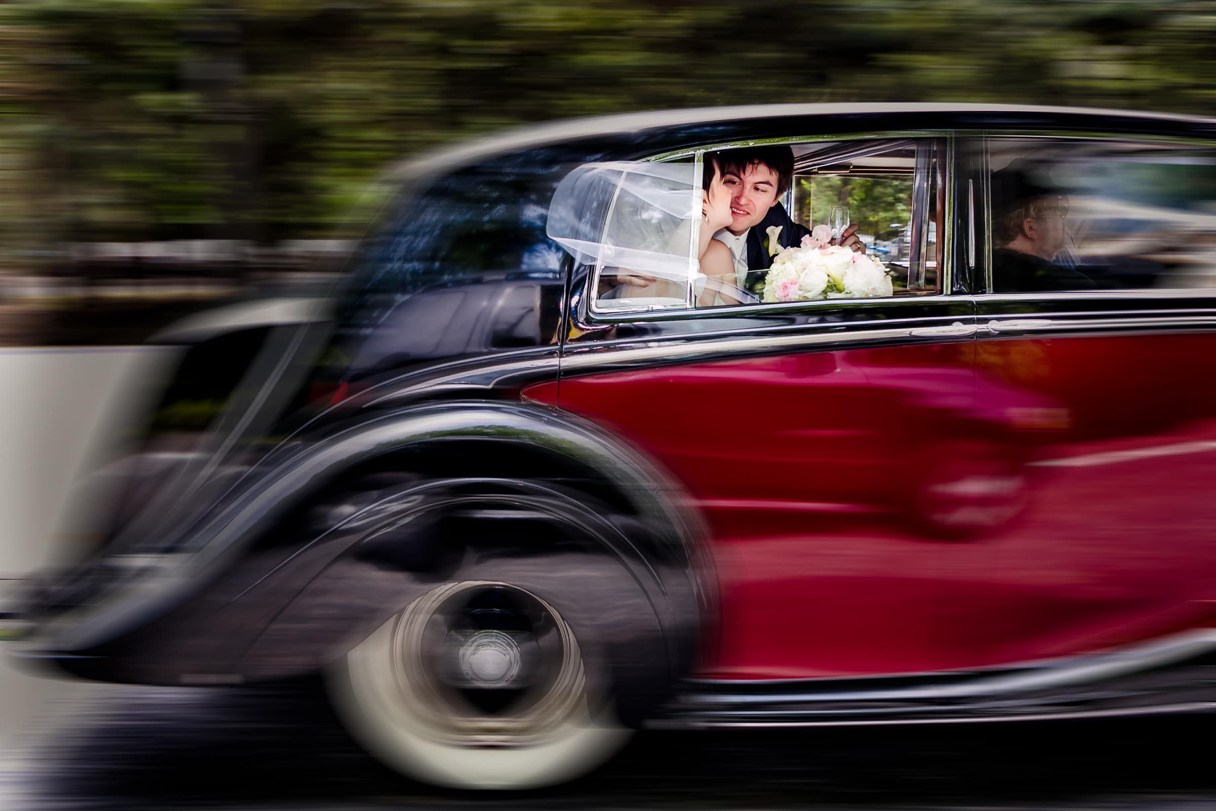 A fun and exciting photo of bride and groom riding in a limousine car heading to their Waverley Country Club wedding