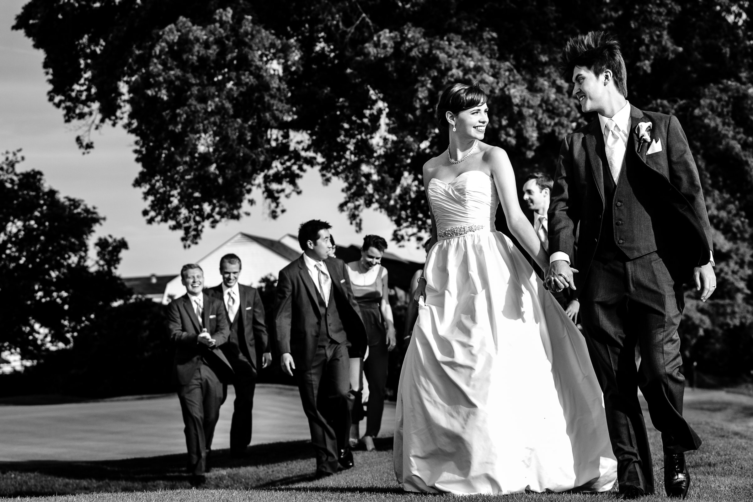Bride and groom walking with friends during their Waverley Country Club wedding