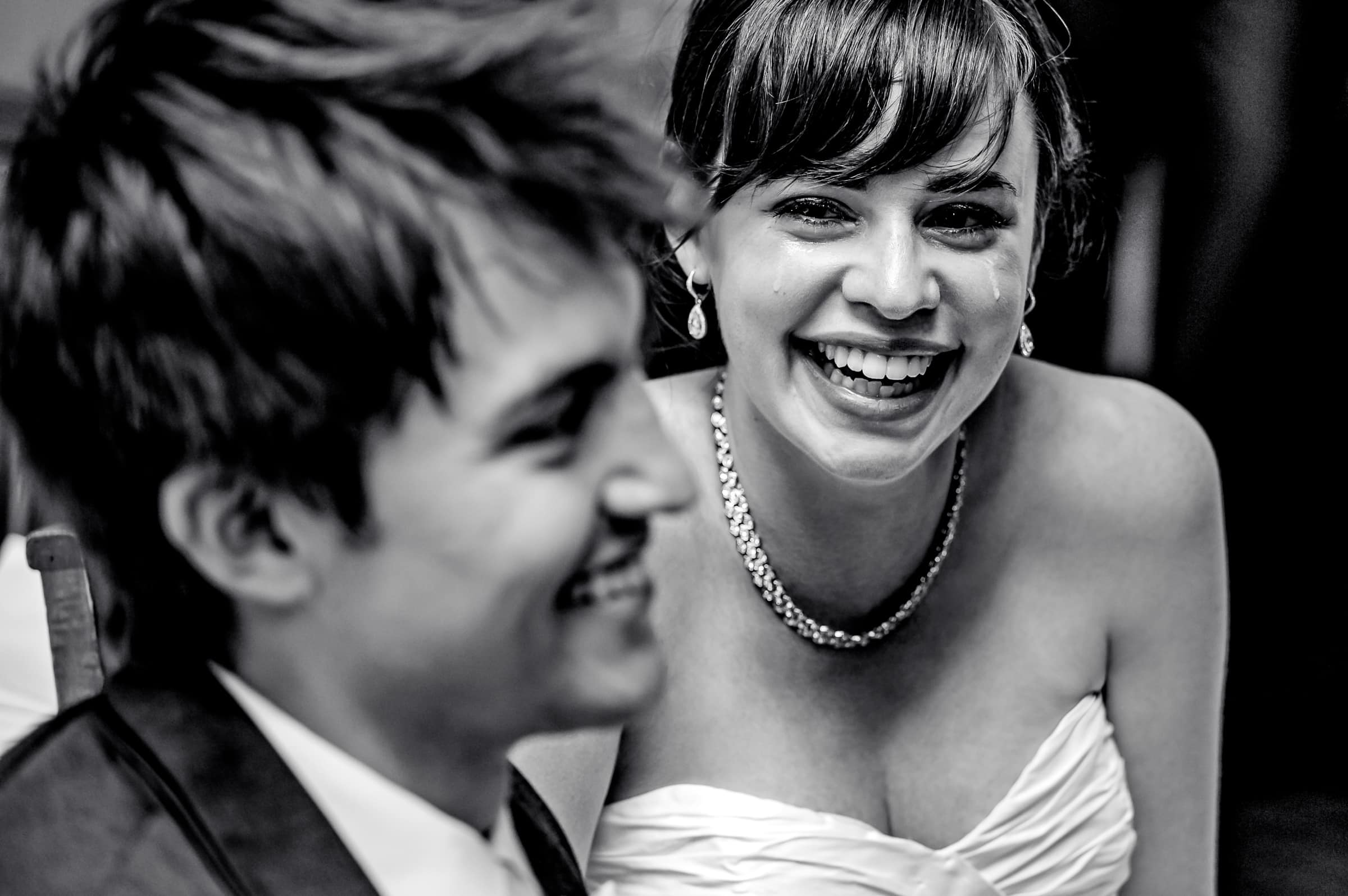 Award winning wedding photo of an emotional bride and groom during their Waverley Country Club wedding reception