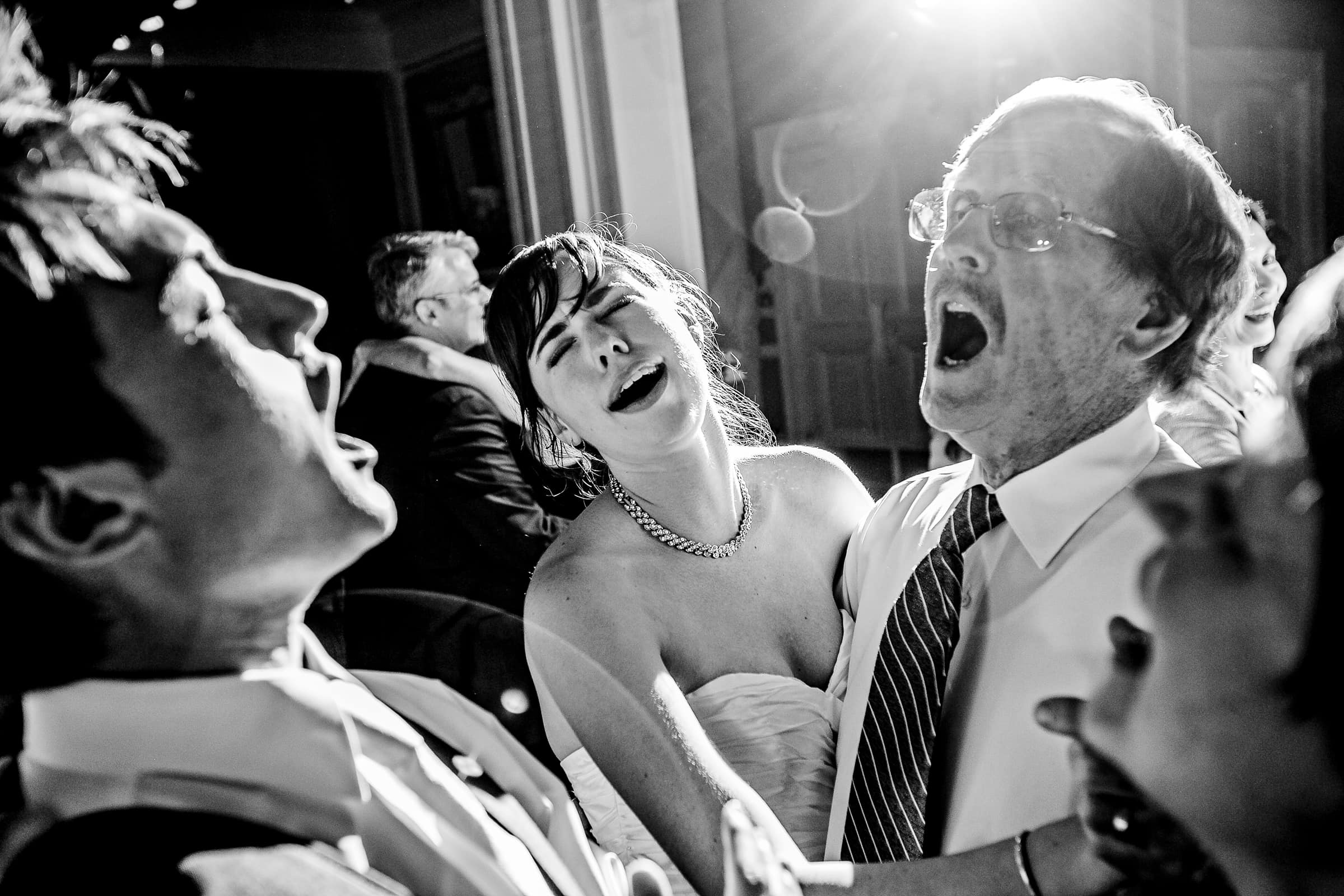 motional bride and groom singing with their father during their Waverley Country Club wedding reception