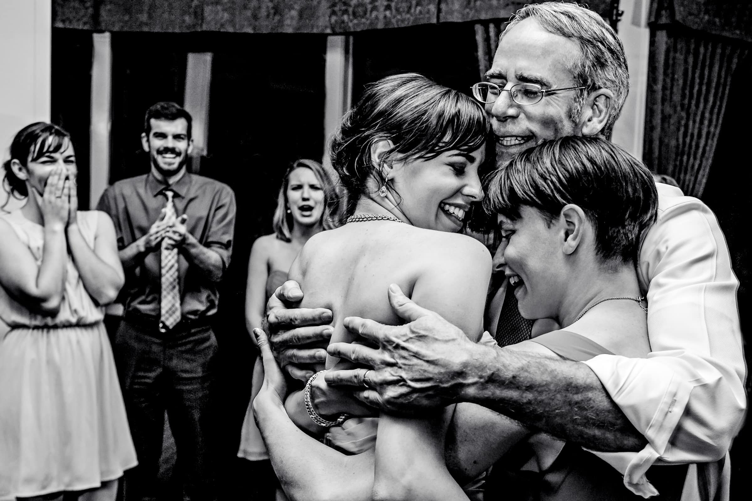 Award winning wedding photo of an emotional bride and her father and sister during their Waverley Country Club wedding reception
