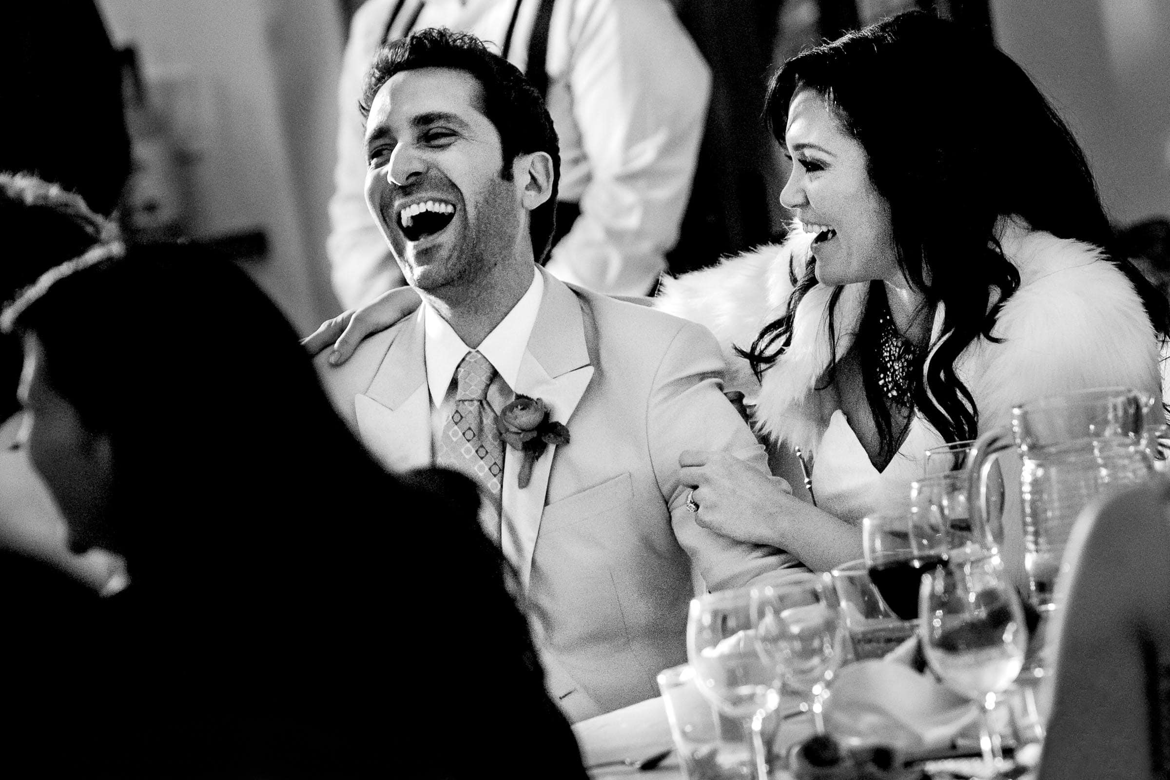 Jay Karas and Monica Osborne bursting into laughter from a famous comedians speech during their Palm Springs Wedding in California at The Bougainvillea Estate