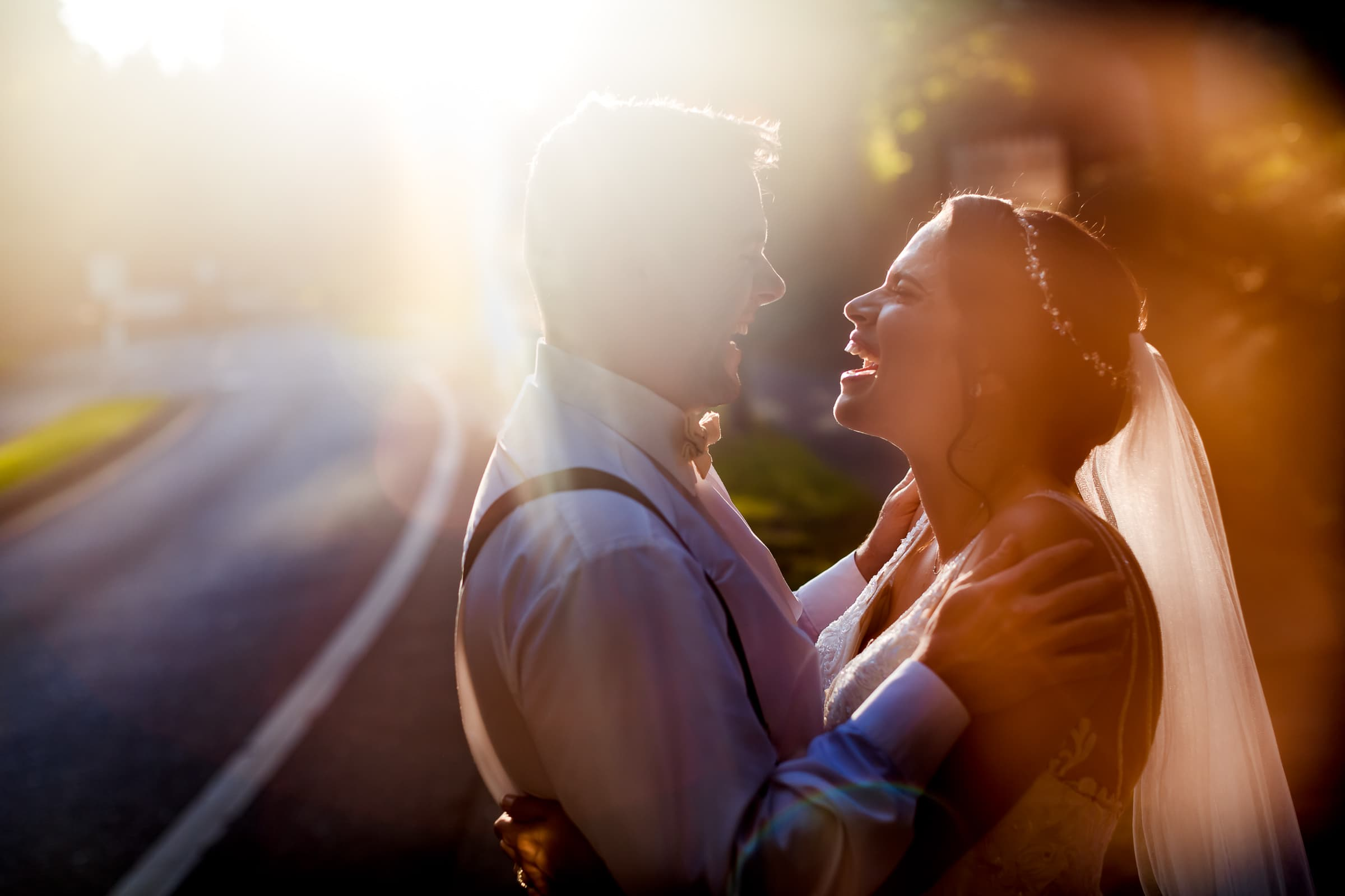 Happy bride and groom laughing in warm sunlight backlight flare during their Portland Wedding elopement