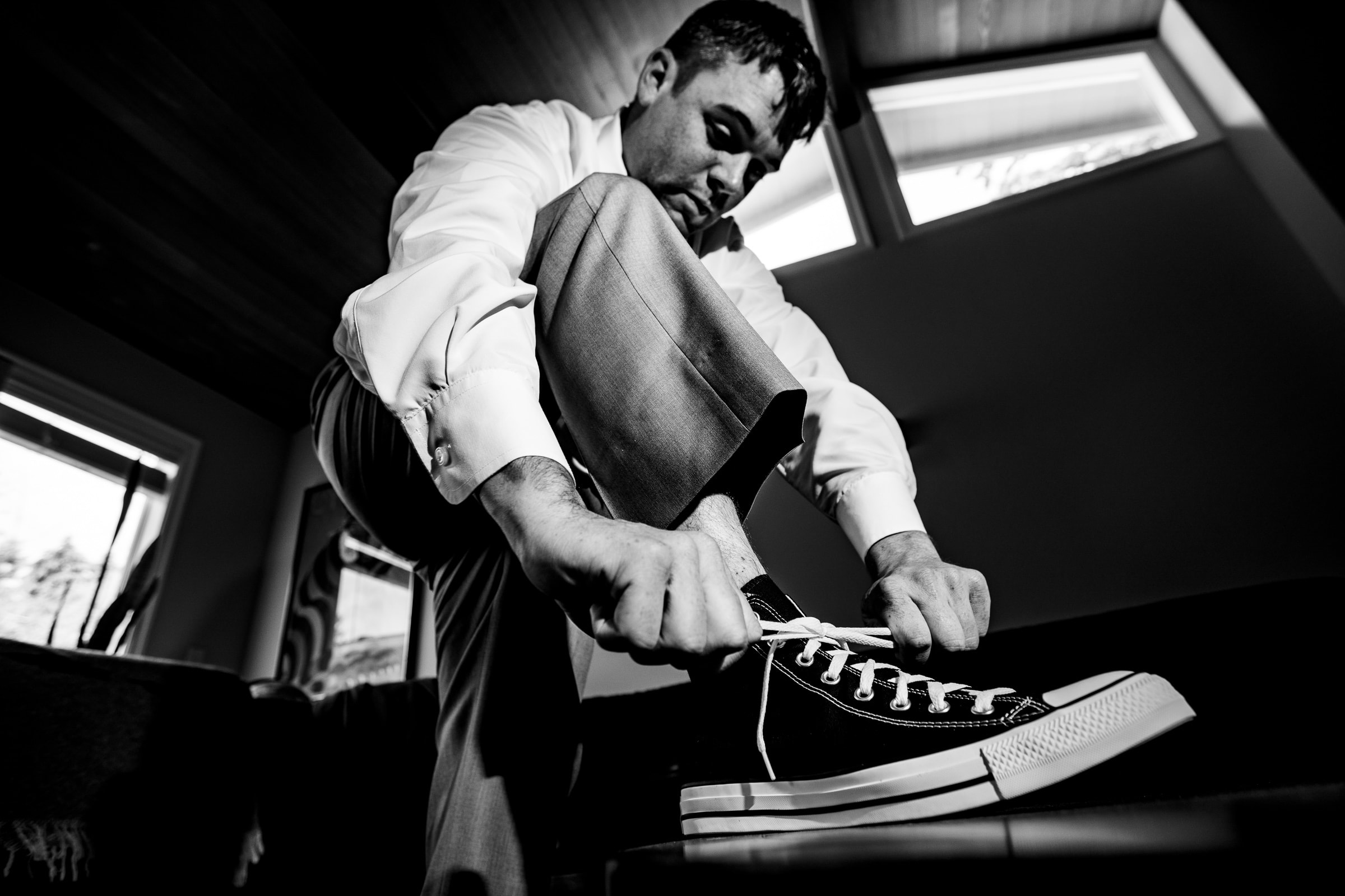 Groom tying shoes for his Portland Wedding elopement