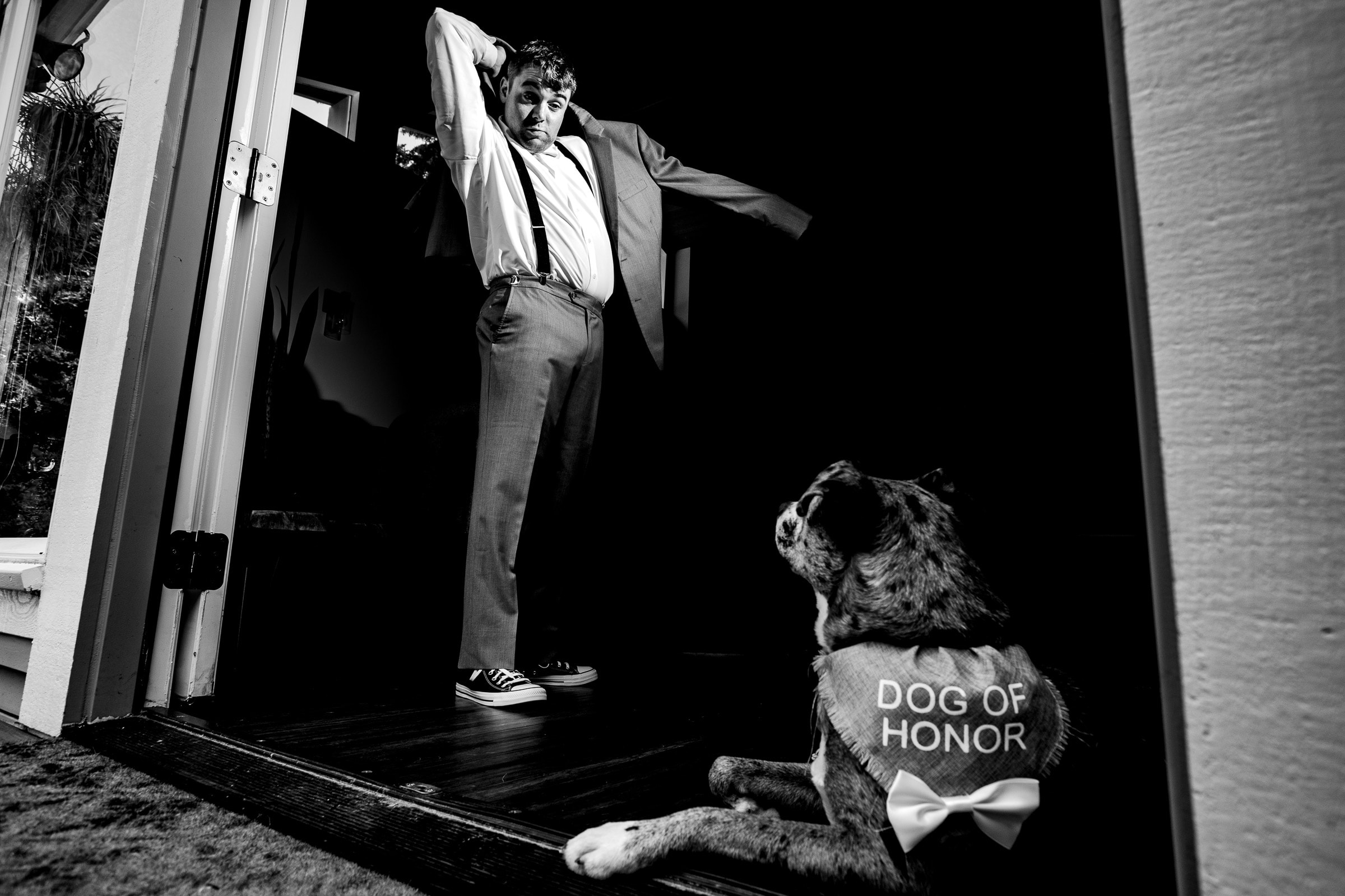 Excellent photo of groom getting ready with his dog of honor for his Portland Wedding elopement