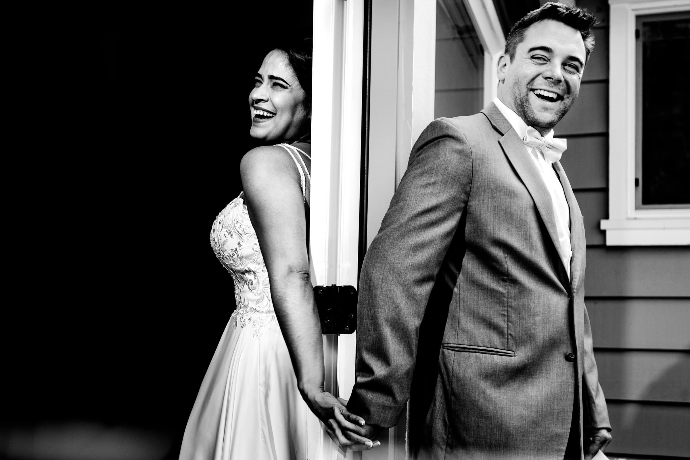 Bride and groom holding hands around a corner moments before their Portland elopement