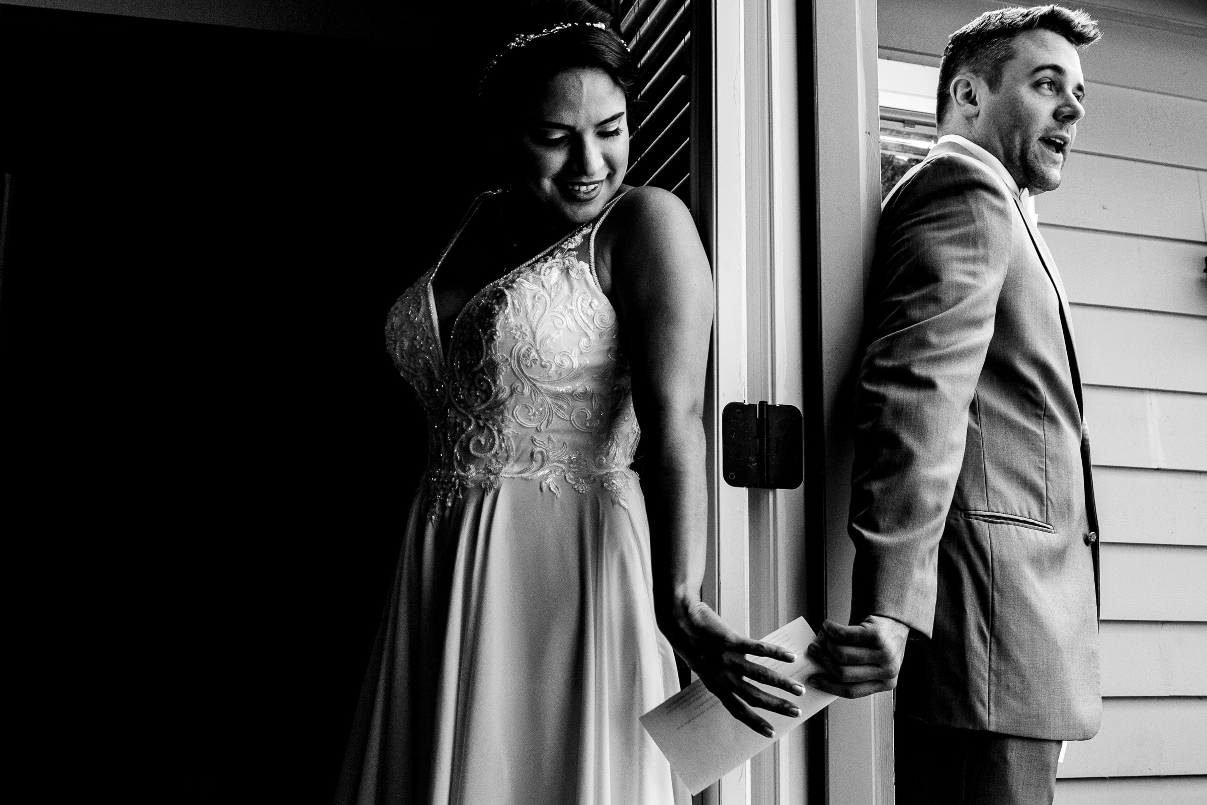 Bride and groom exchanging a note around a corner before their Portland Wedding elopement