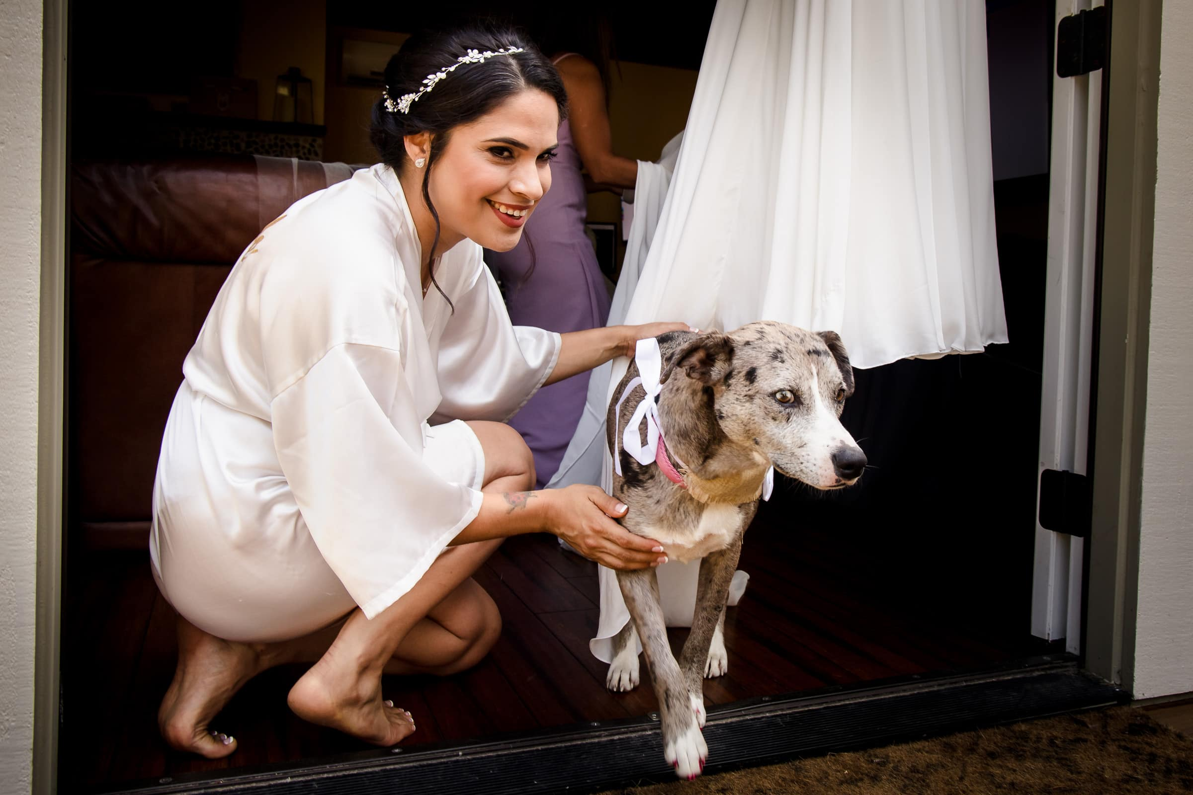 Bride with a beautiful dog while getting ready for her Portland Wedding elopement