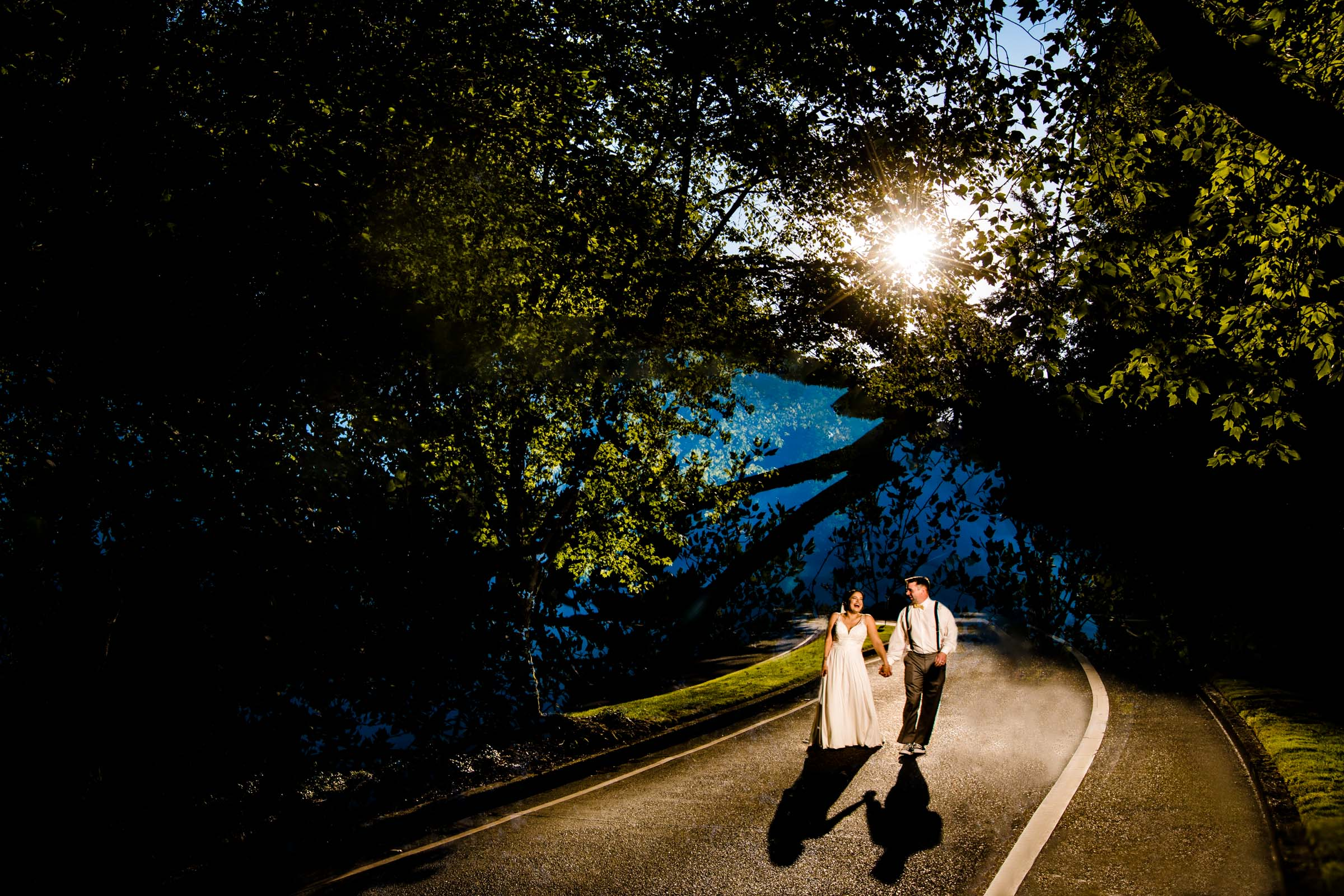 Bride and groom walking in warm sunset light during their Portland Wedding elopement