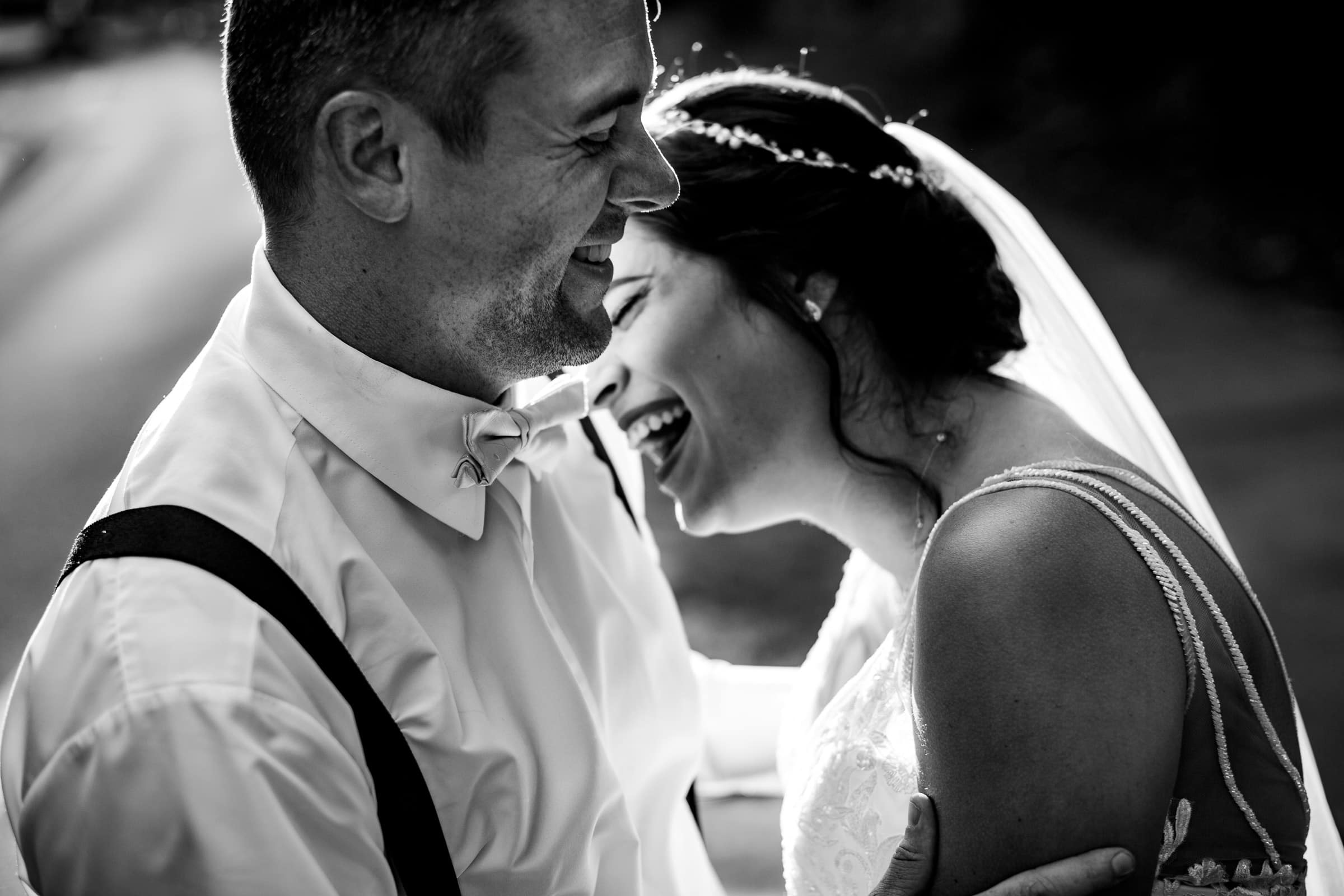 Bride and groom laughing in beautiful light during their Portland Wedding elopement