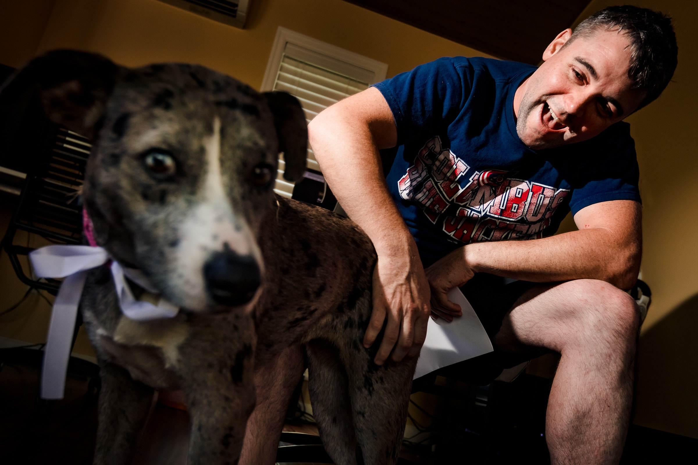 Groom with his dog while getting ready for his Portland Wedding elopement