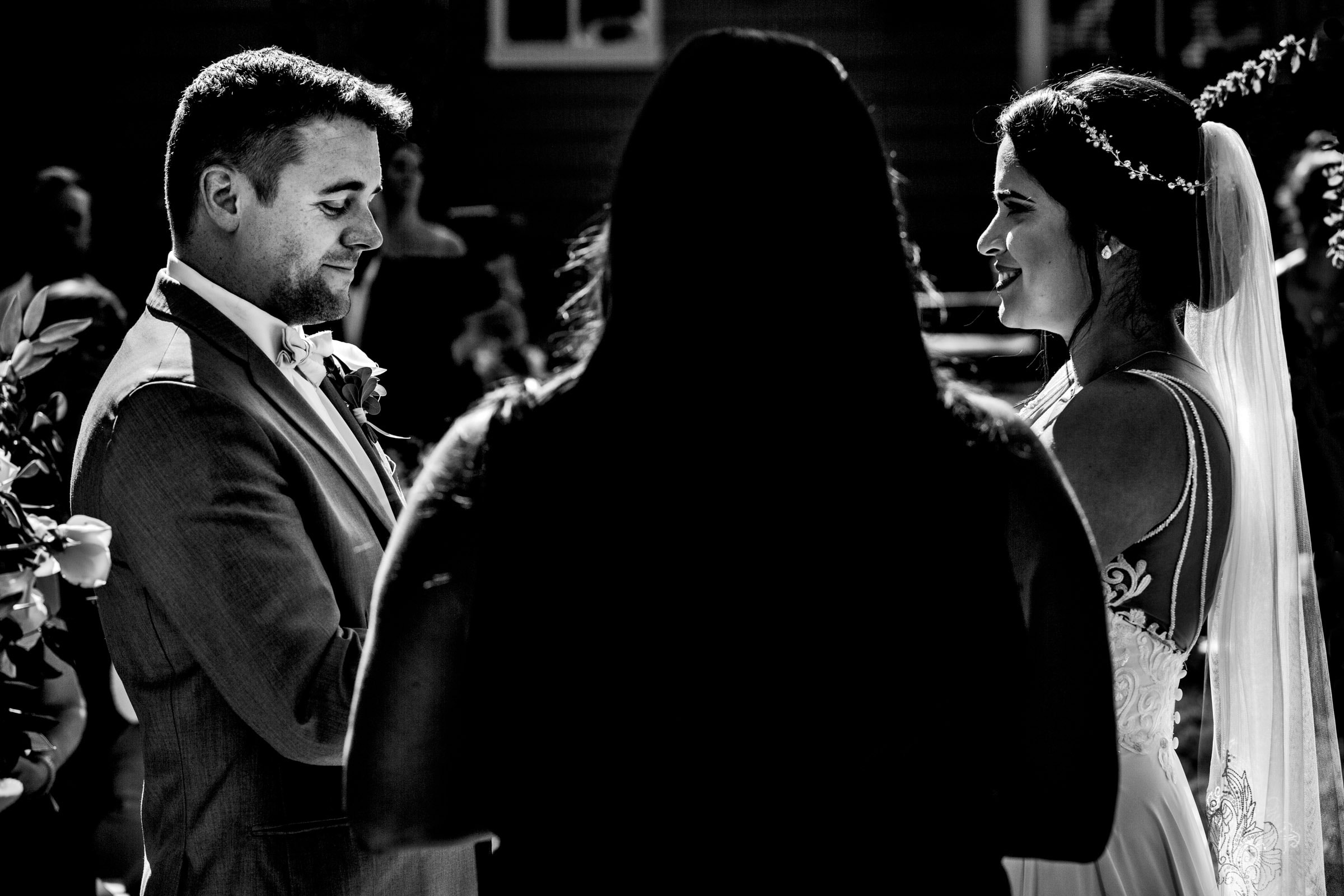 bride and groom standing and looking into one another during a backyard Portland wedding ceremony during COVID