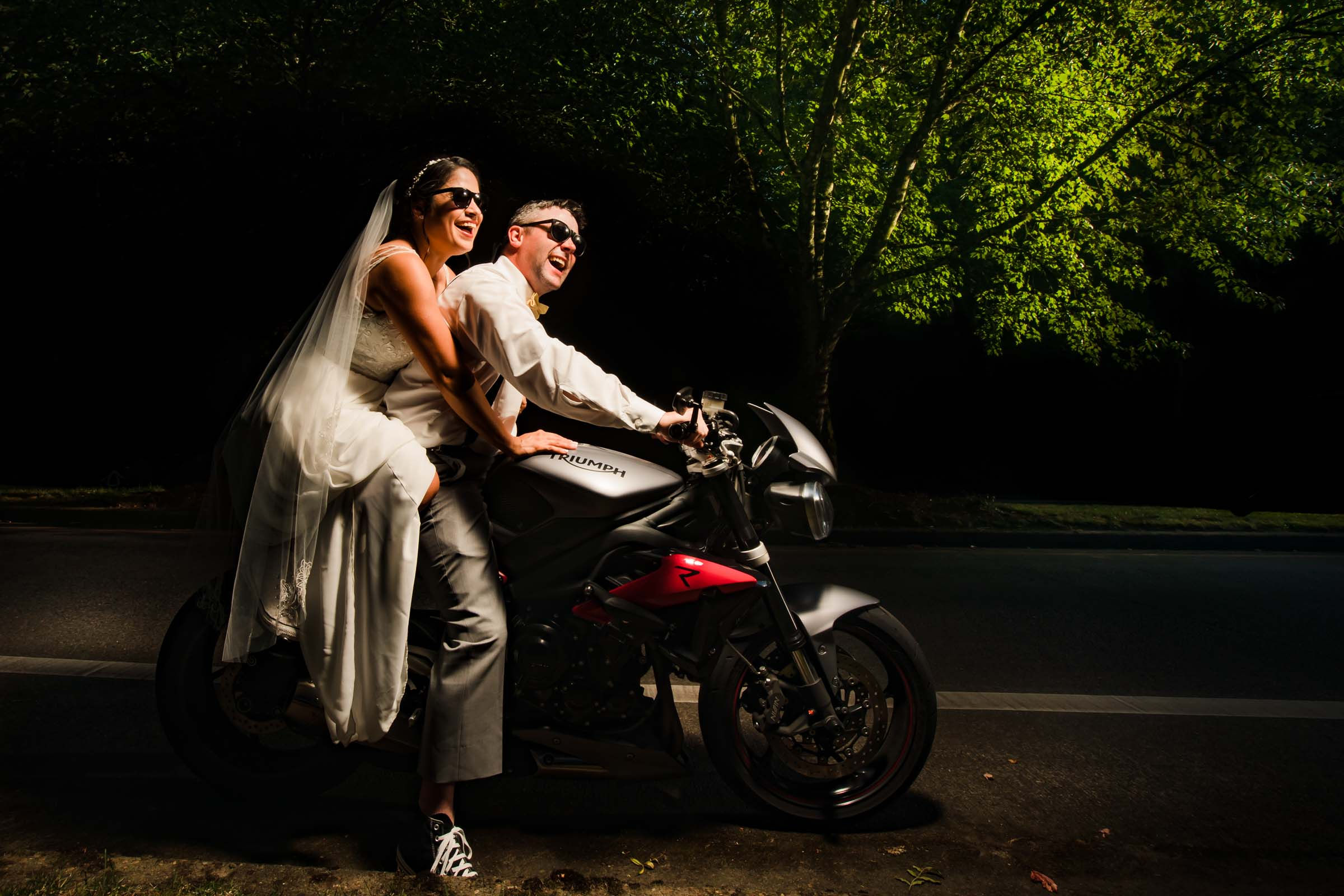 Bride and groom on a motorcycle headed to their wedding reception during their Portland wedding during COVID