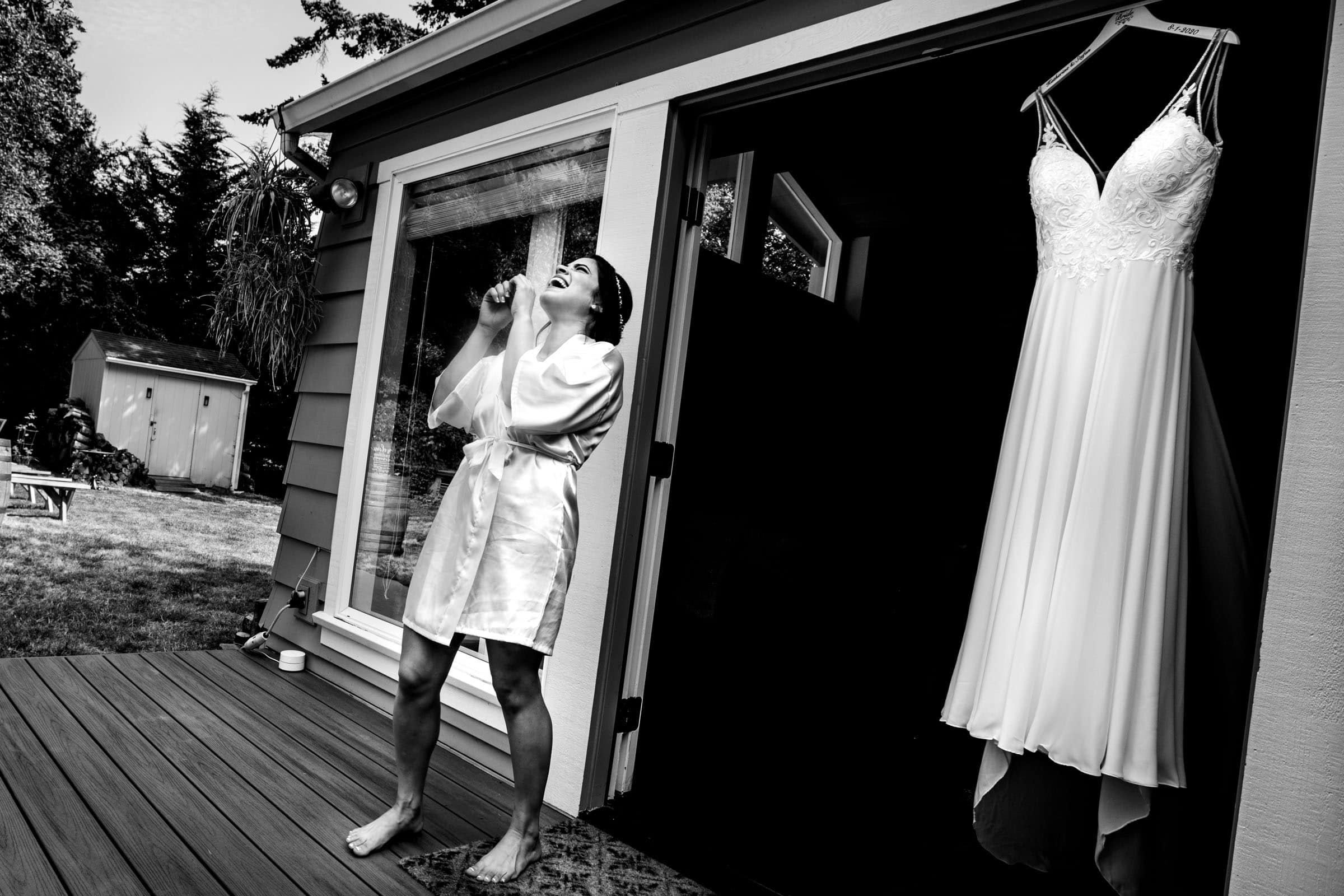 Bride laughing and crying near her dress before her Portland elopement during COVID