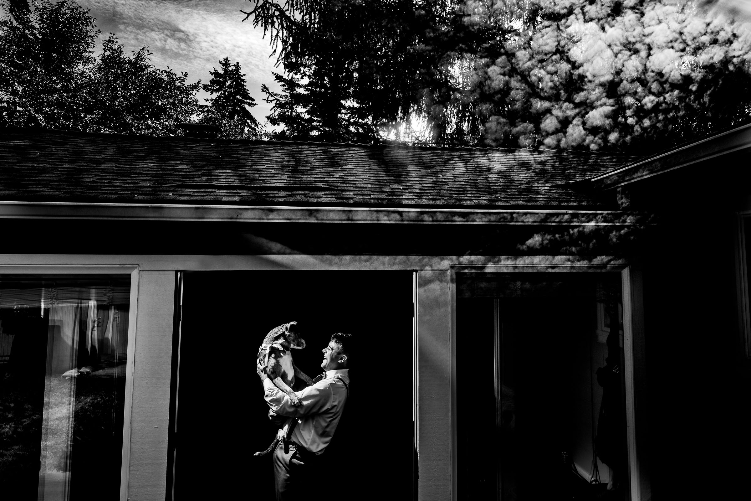 Groom laughing with his dog during his Portland Wedding elopement