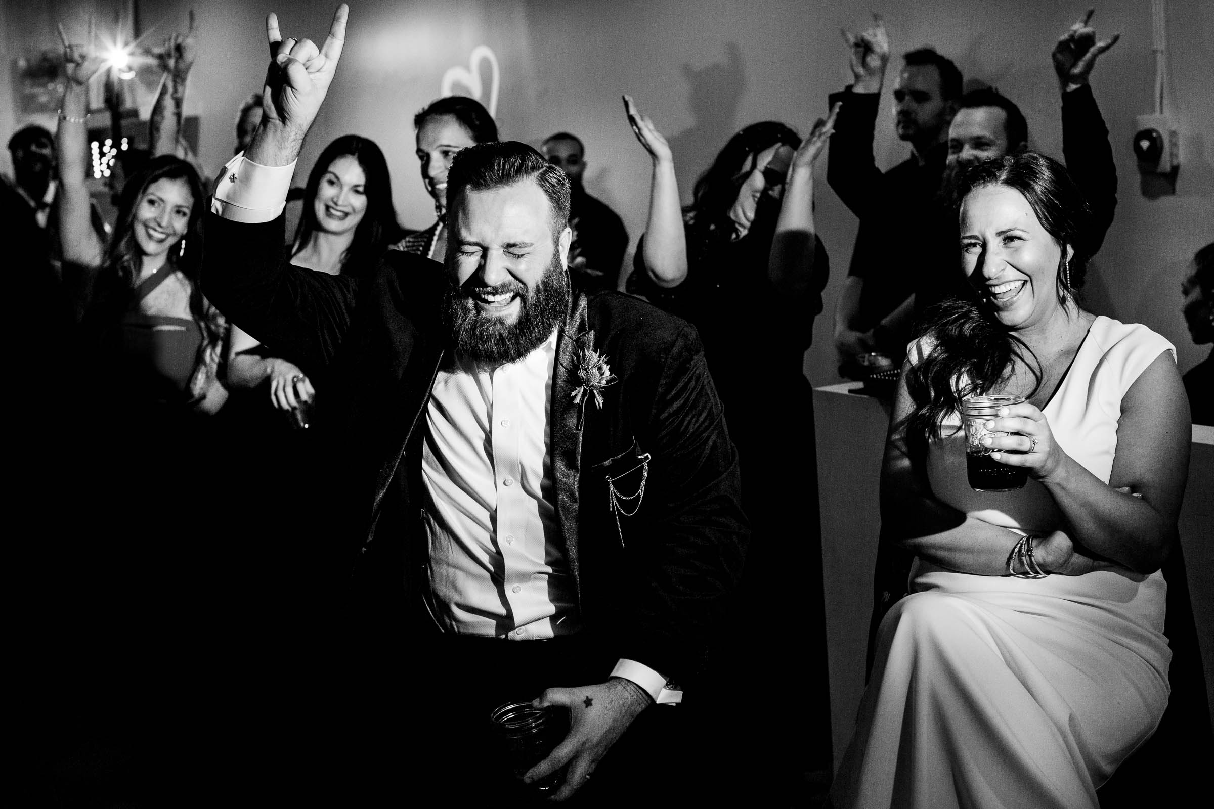 Bride and groom laughing during speeches at a Los Angeles wedding reception
