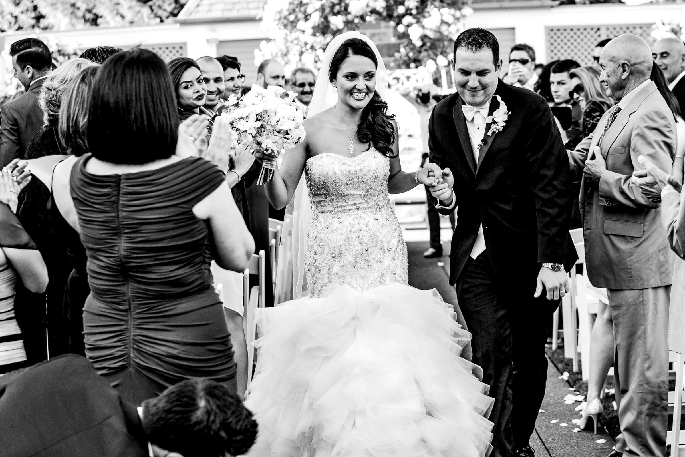 Bride and groom exiting their Oregon Golf Club wedding ceremony in Lake Oswego, Oregon just outside Portland