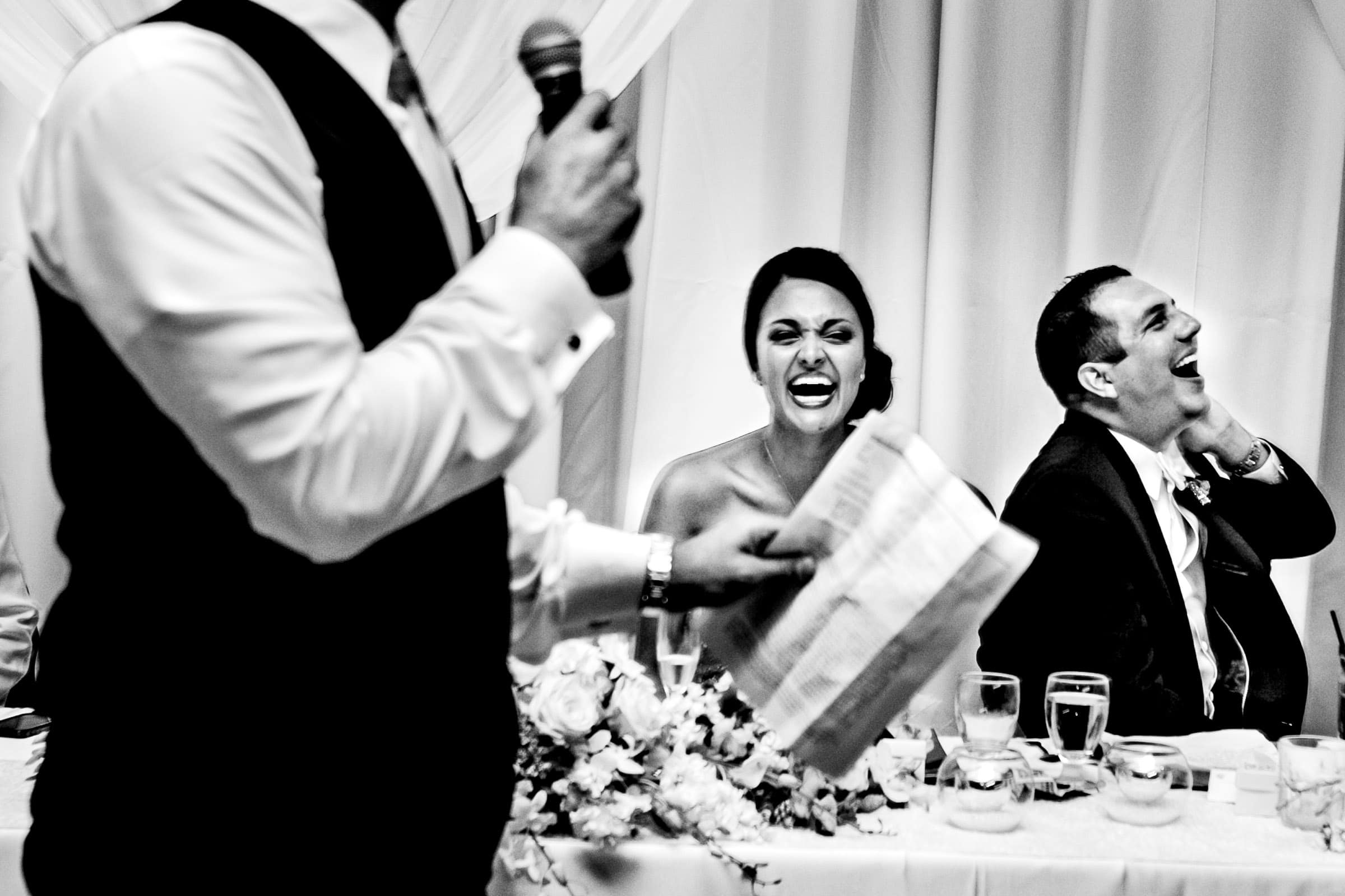 Fantastic photo of a bride and groom laughing during a Oregon Golf Club wedding celebration best man speech in Lake Oswego, Oregon just outside Portland