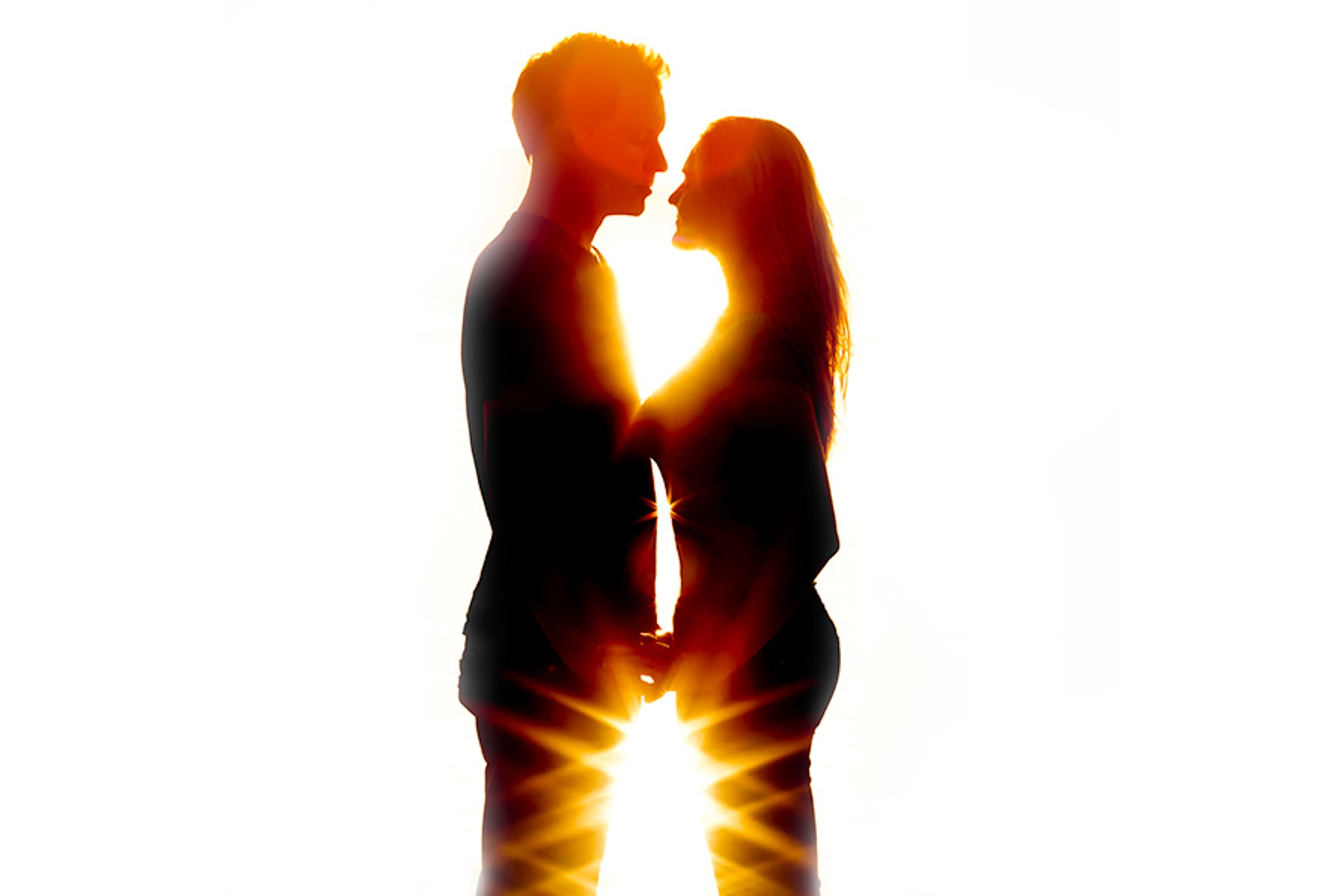 San Francisco Engagement photo of couple with sunset back light flaring around their bodies
