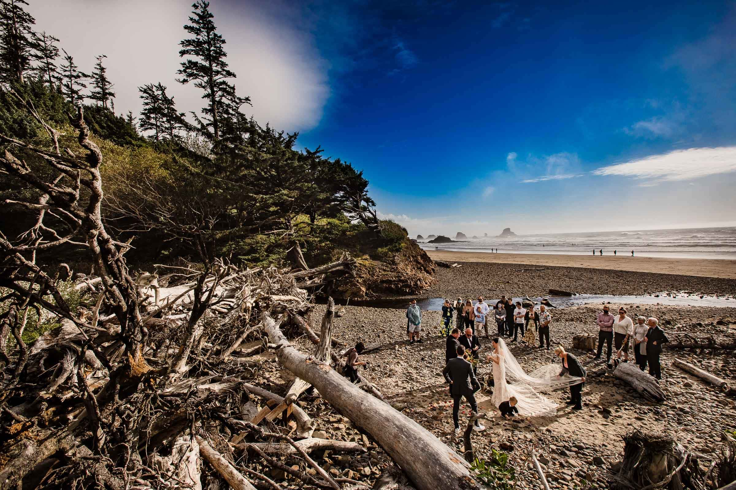 Epic Cannon beach elopement ceremony with blue sky and warm sun