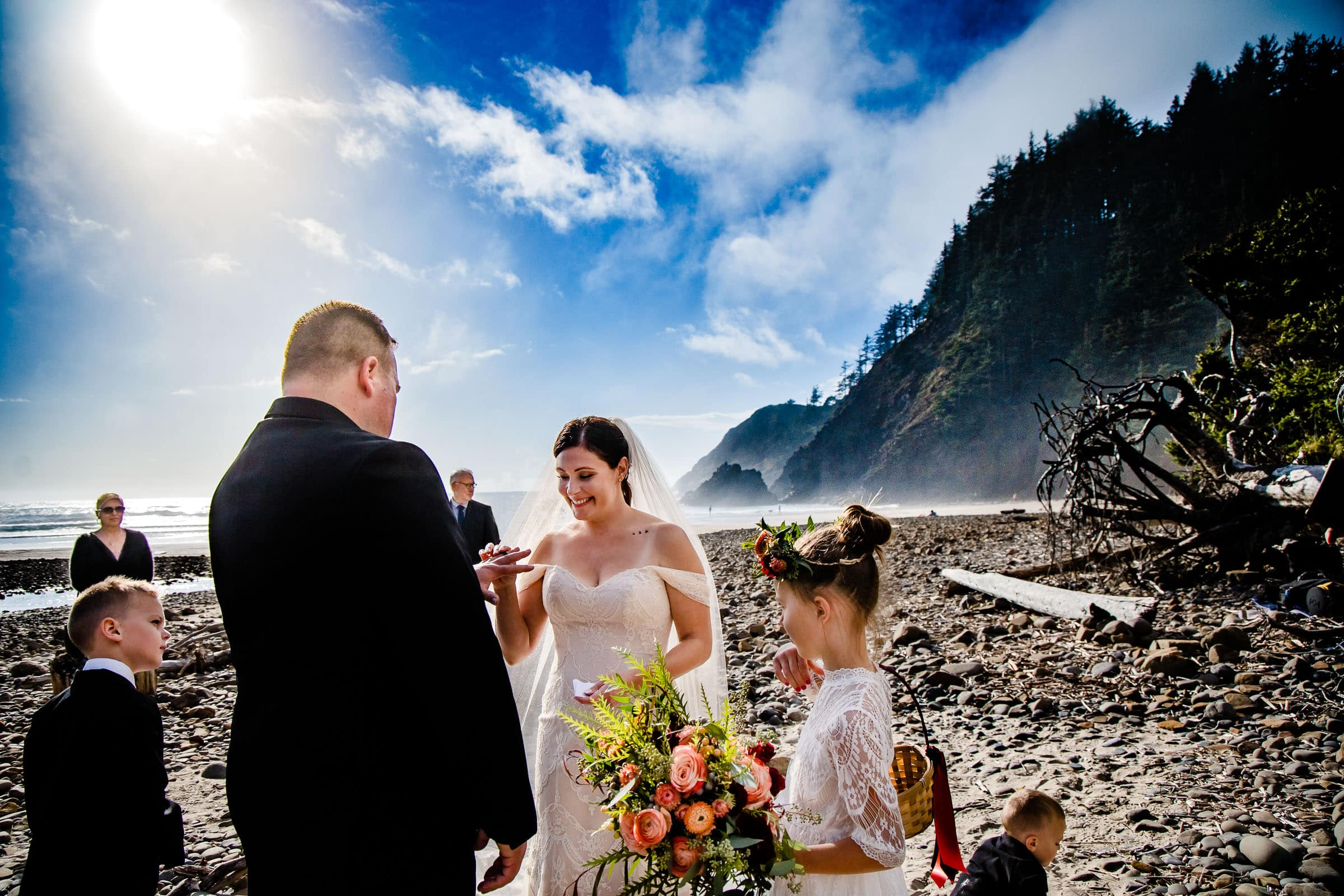 Cannon Beach elopement ceremony with rings being exchanged