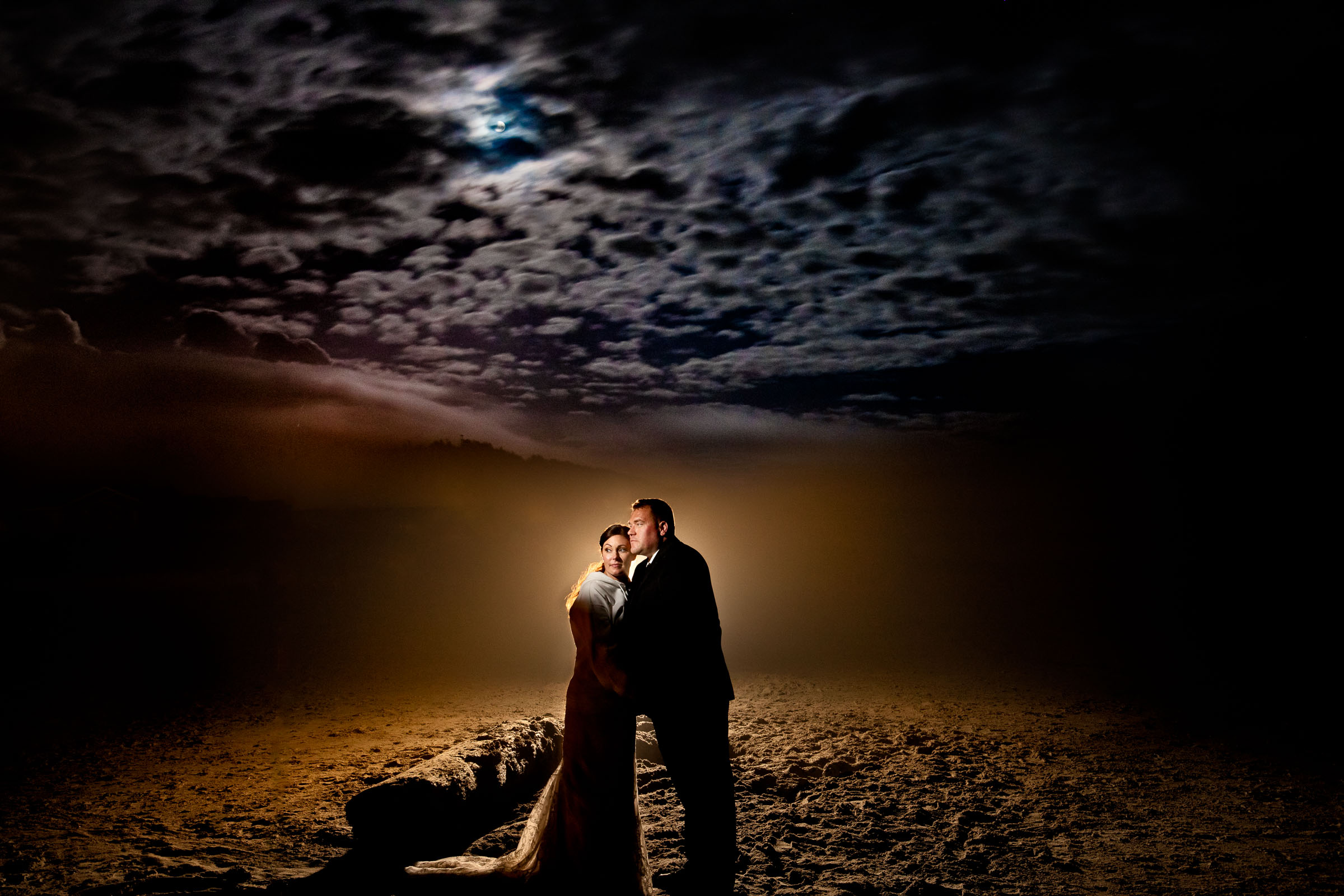 Epic night photo of bride and groom during their Cannon beach elopement reception