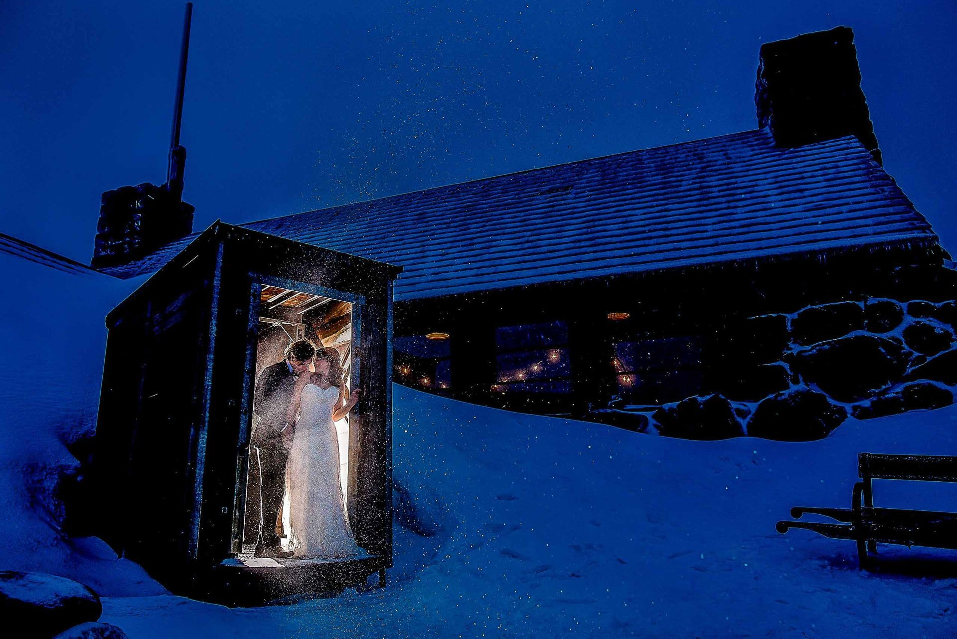 Bride and groom in the doorway at Silcox Hut atop Mt Hood above Timberline Lodge