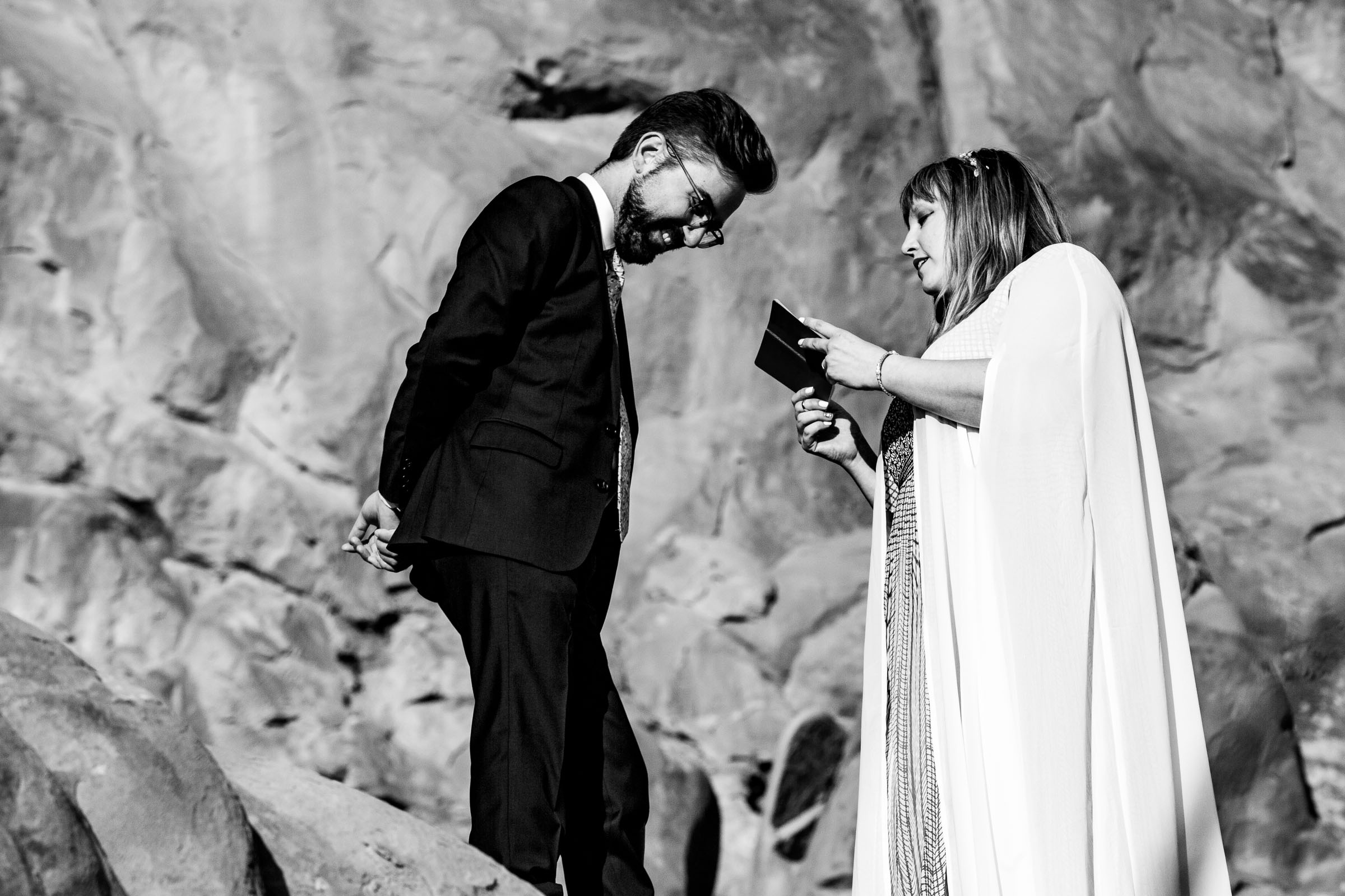 Bride and groom saying vows to each other in Arches National Park in Moab Utah for their adventure elopement