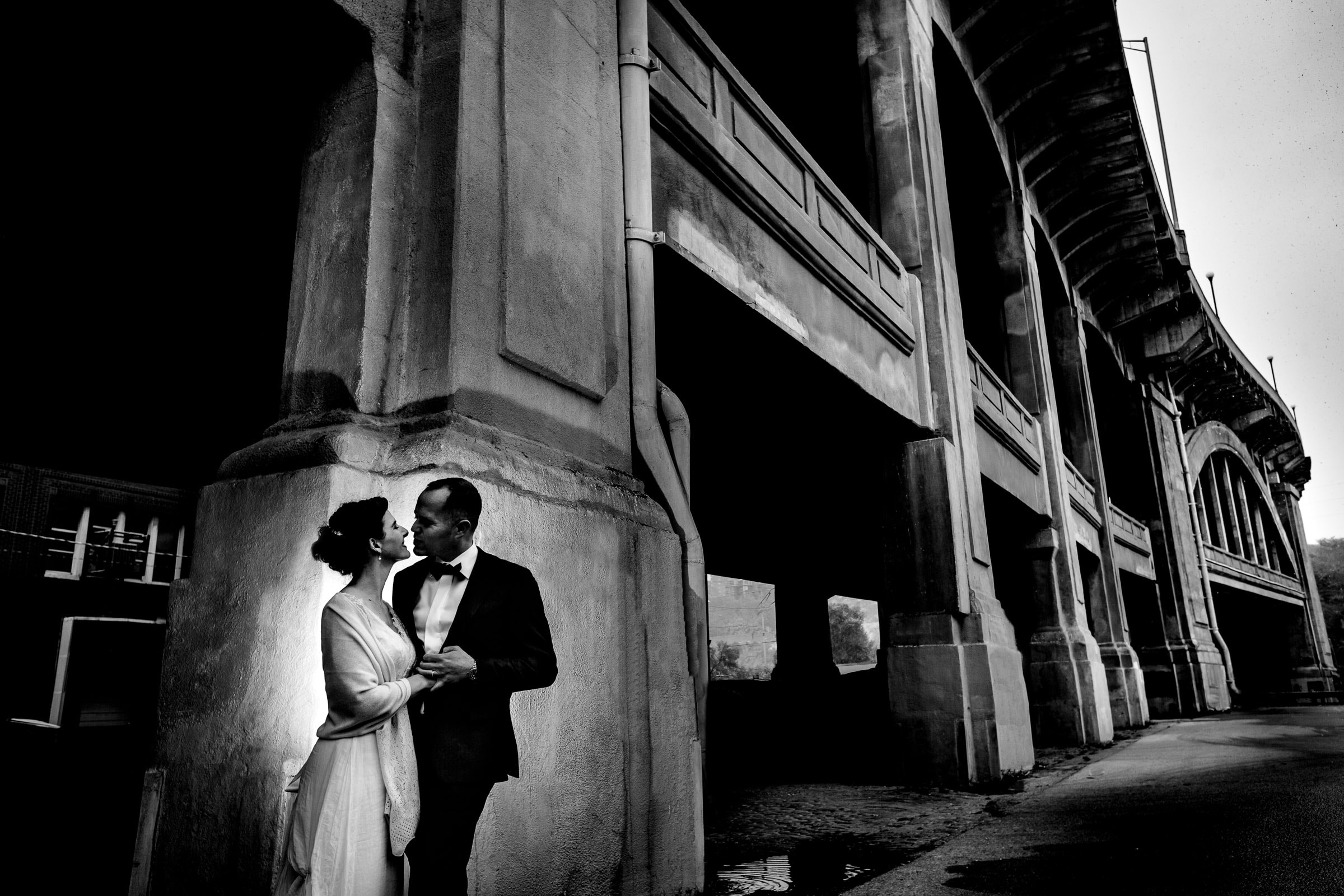 Bride and Groom under Crossroads bridge during their Kansas City Elopement