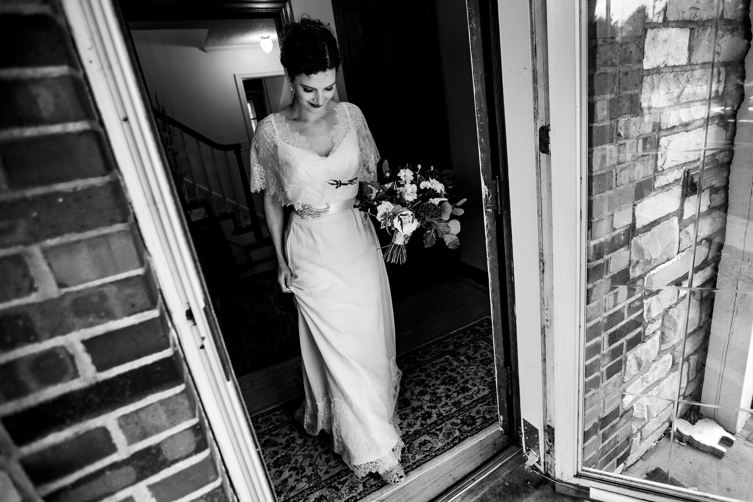Bride walking toward ceremony at the Pilgrim Chapel in Kansas City Missouri for a Kansas City elopement.