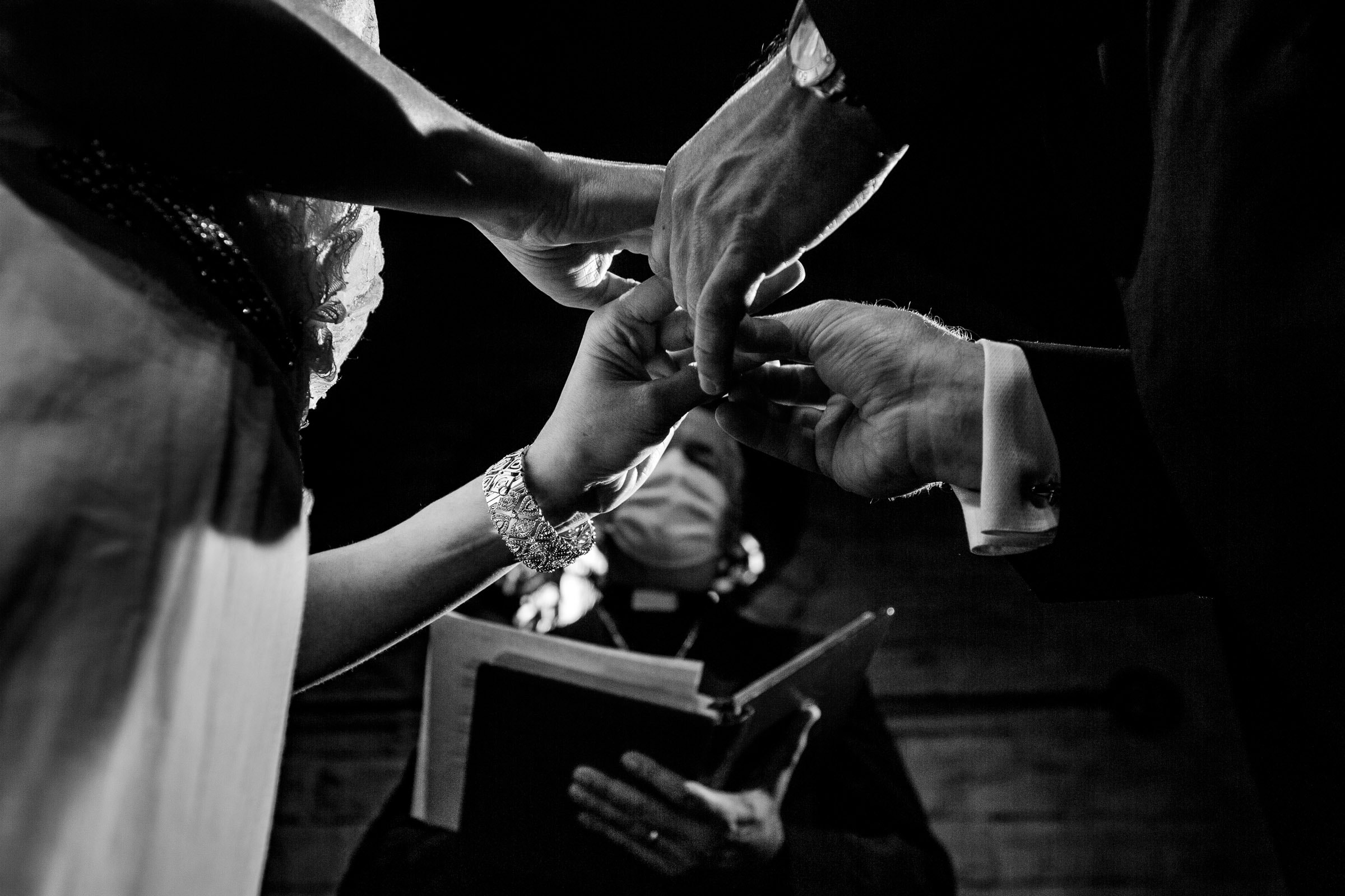 Bride and groom exchanging rings during their Kansas City elopement ceremony at the Pilgrim Chapel