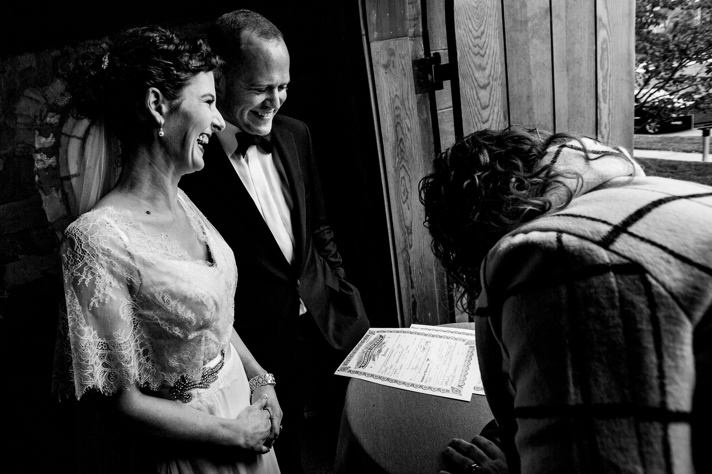 Bride and Groom signing wedding certificate at their Kansas City elopement ceremony at the Pilgrim Chapel