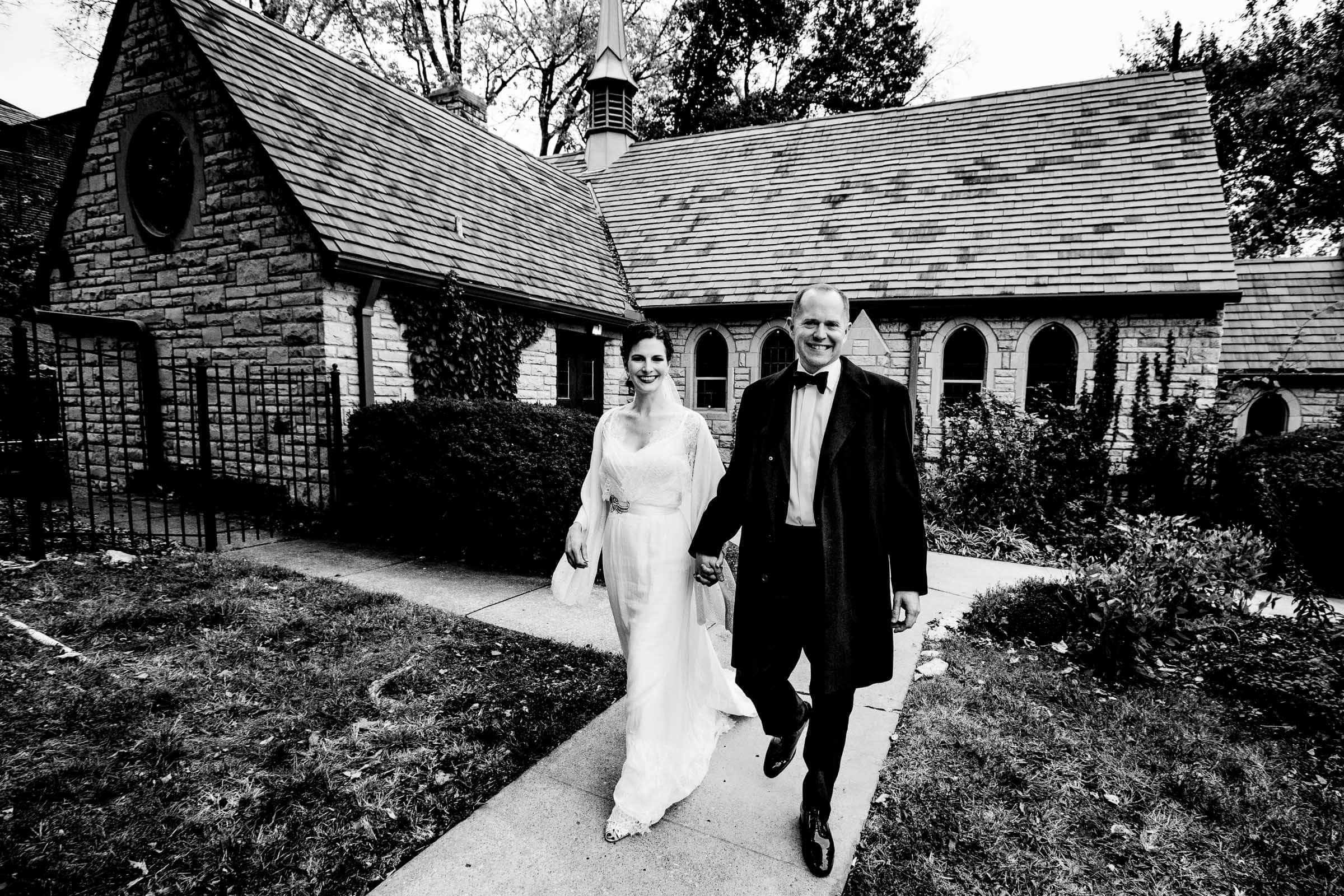 Bride and Groom walking away after their Kansas City elopement ceremony at the Pilgrim Chapel