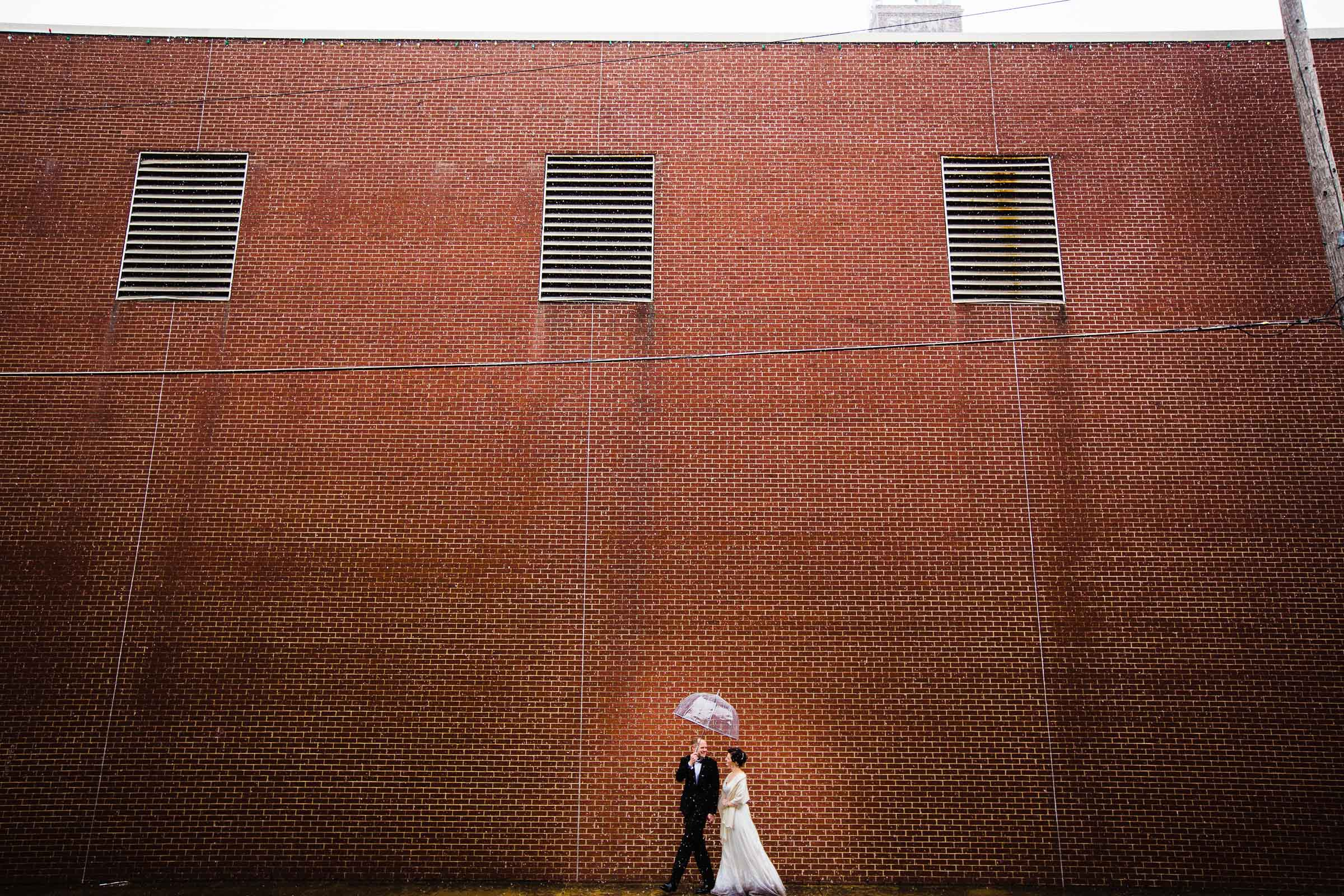 Bride and Groom exploring city backdrops after their Kansas City elopement ceremony at The Pilgrim Chapel.