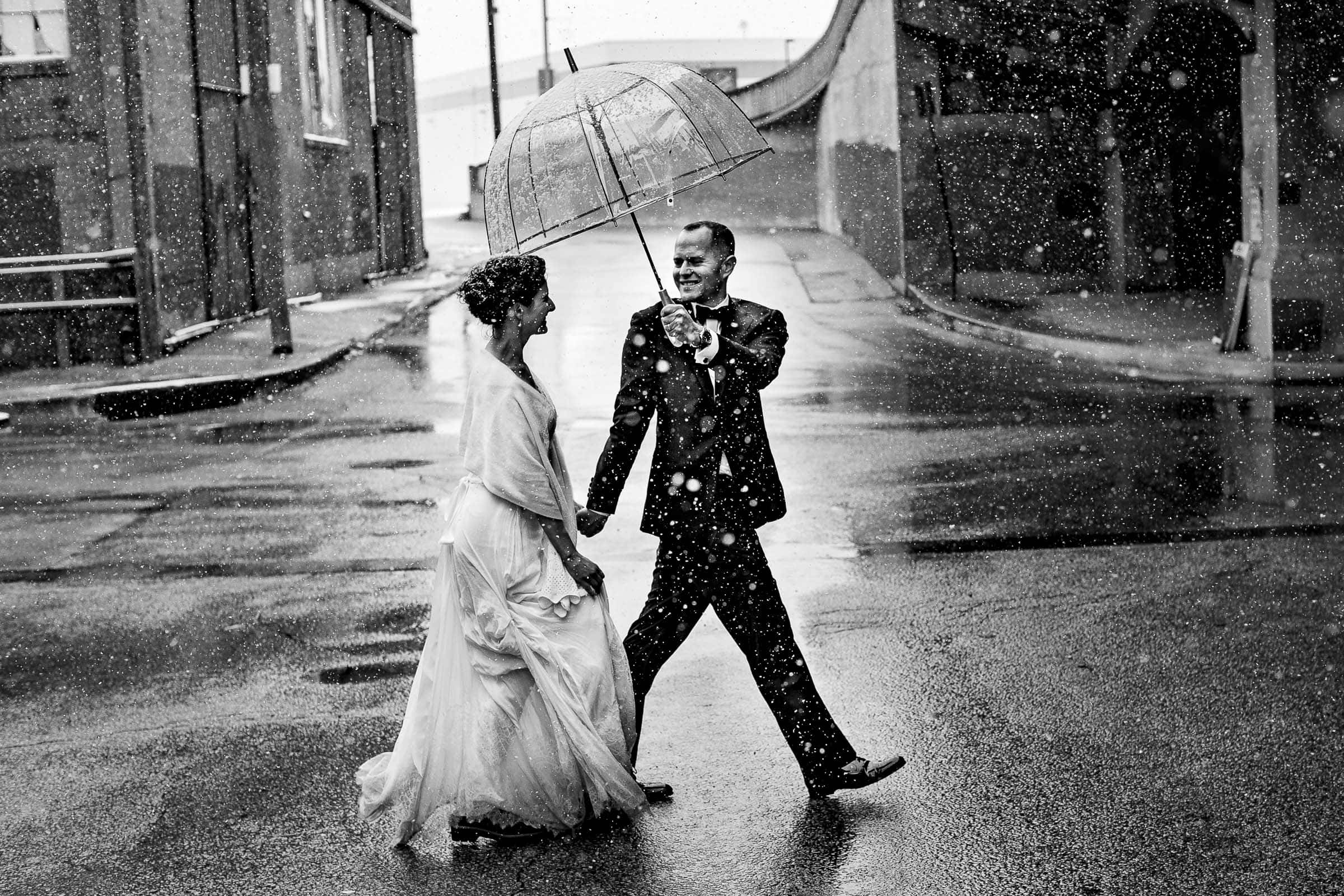 Bride and Groom walking and enjoying in the snow after their Kansas City elopement ceremony at The Pilgrim Chapel.