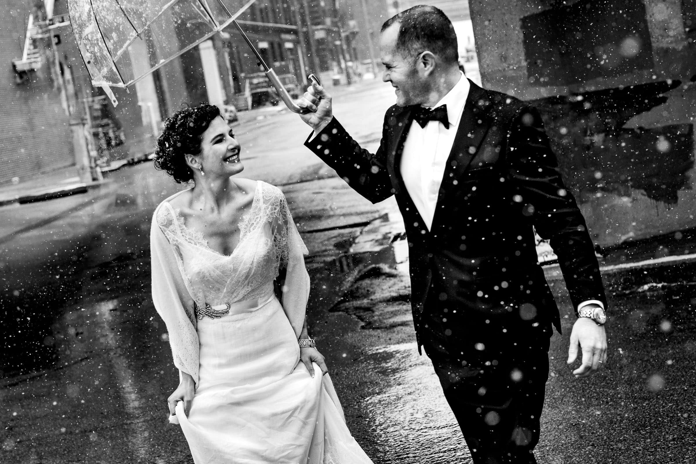 Bride and Groom walking through the snow after their Kansas City elopement ceremony at The Pilgrim Chapel.
