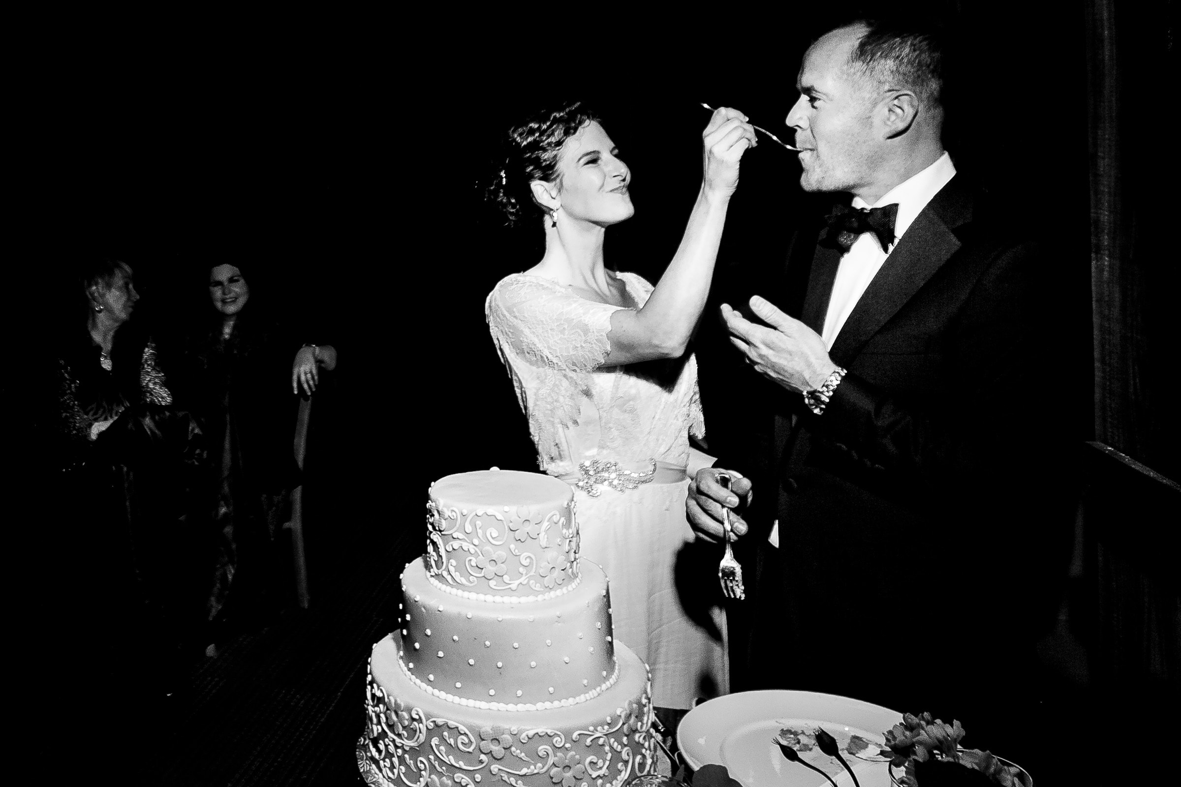 Bride feeding groom cake at Lidia's during their Kansas City elopement reception after their wedding at The Pilgrim Chapel.