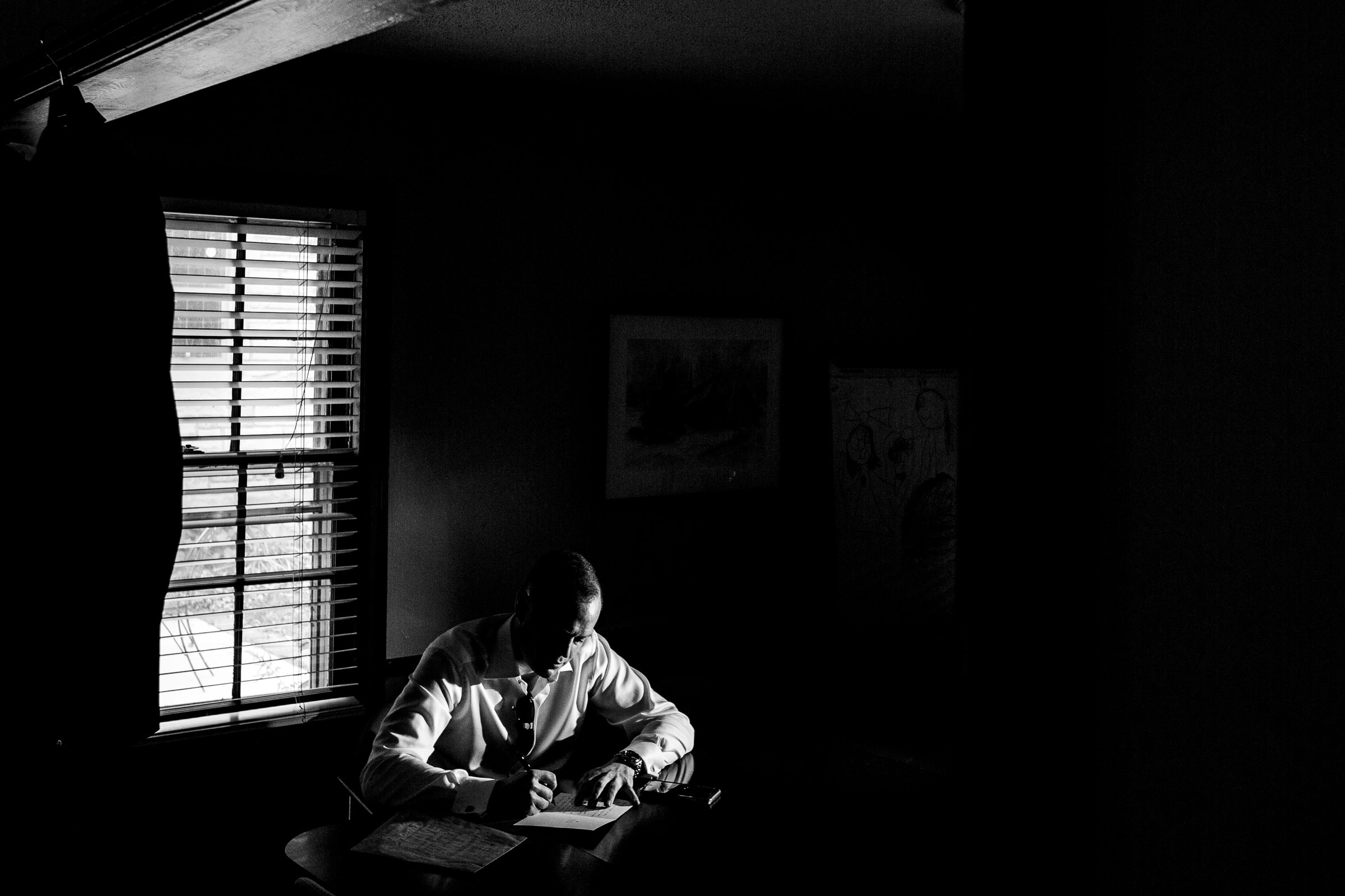 Groom writing vows for his small Kansas City elopement