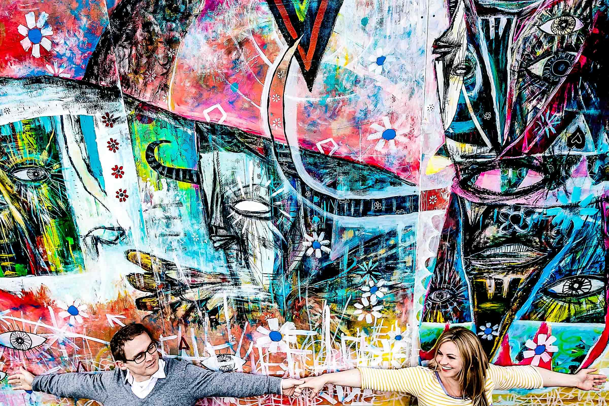 Artistic engagement portrait of a couple in the Alberta Arts District in Portland Oregon