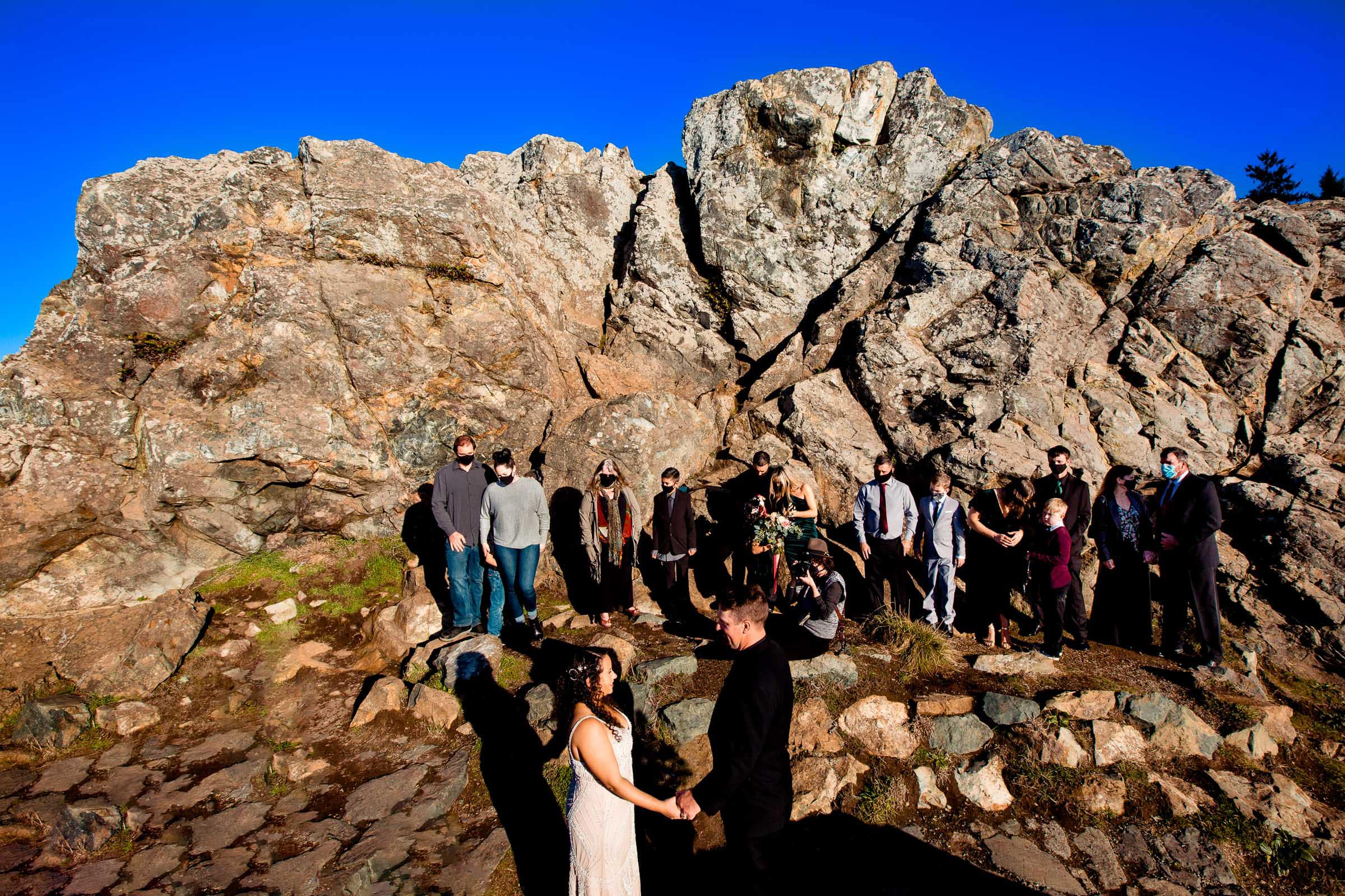 Bride and groom exchanging vows on Wedding Rock for their Patricks Point elopement ceremony with immediate family