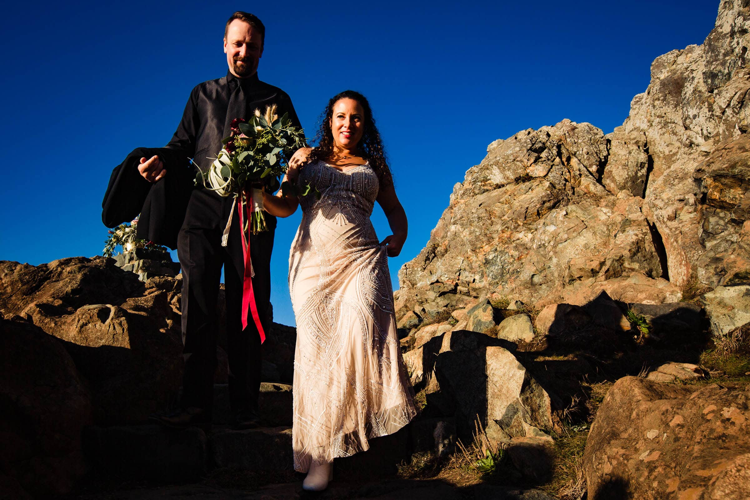 Bride and groom exiting their Patricks Point elopement ceremony on Wedding Rock near Trinidad California