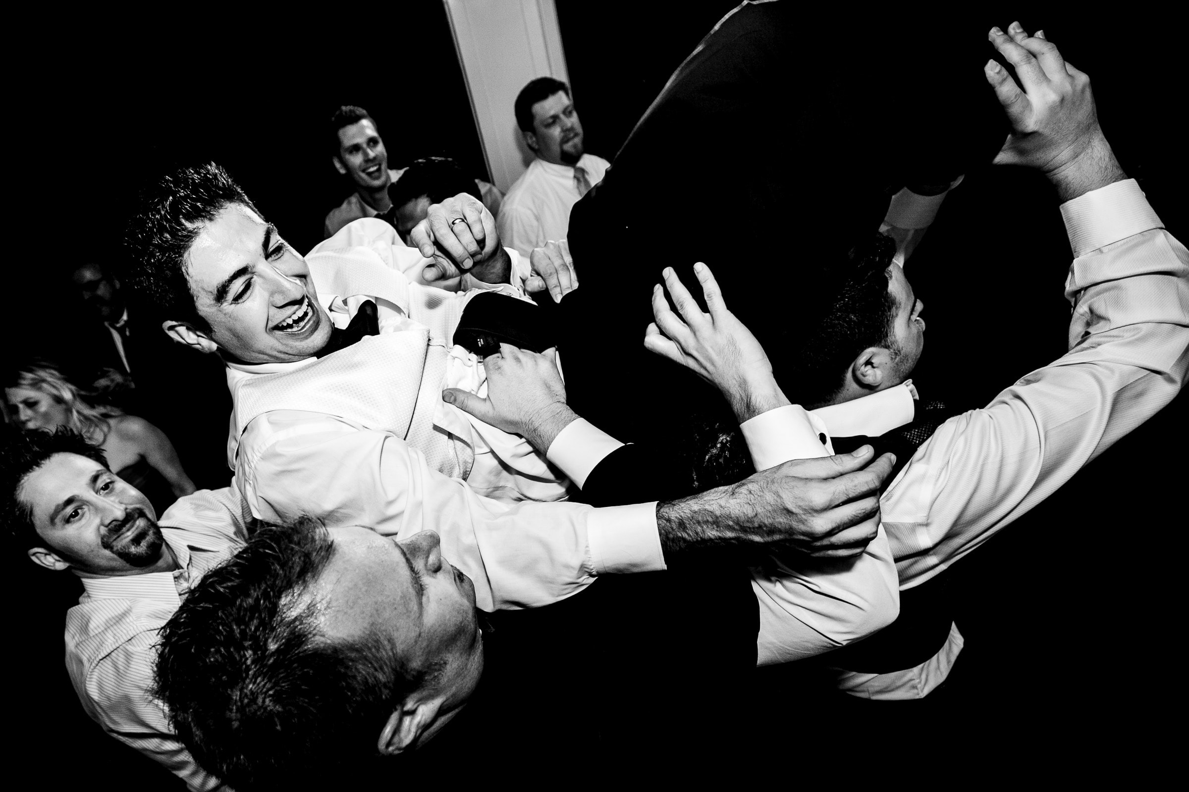 Groom being tossed by groosmen during a Waverley Country Club reception in Lake Oswego, Oregon just outside Portland