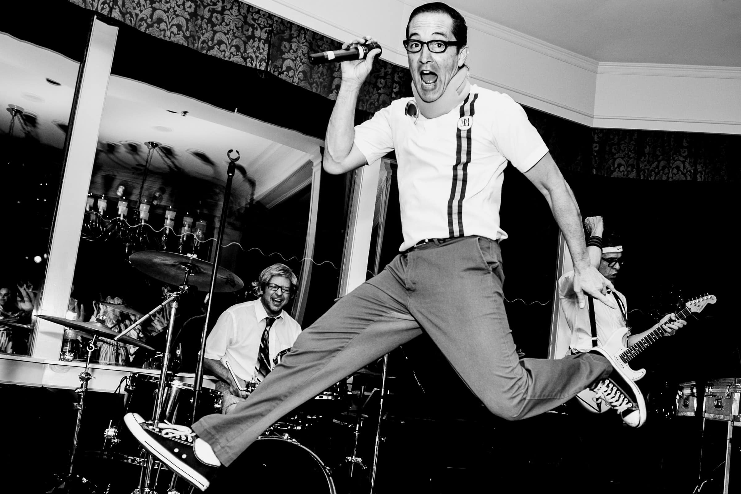 Crazy fun musician dancing and flying during a Waverley Country Club wedding in Lake Oswego, Oregon just outside Portland