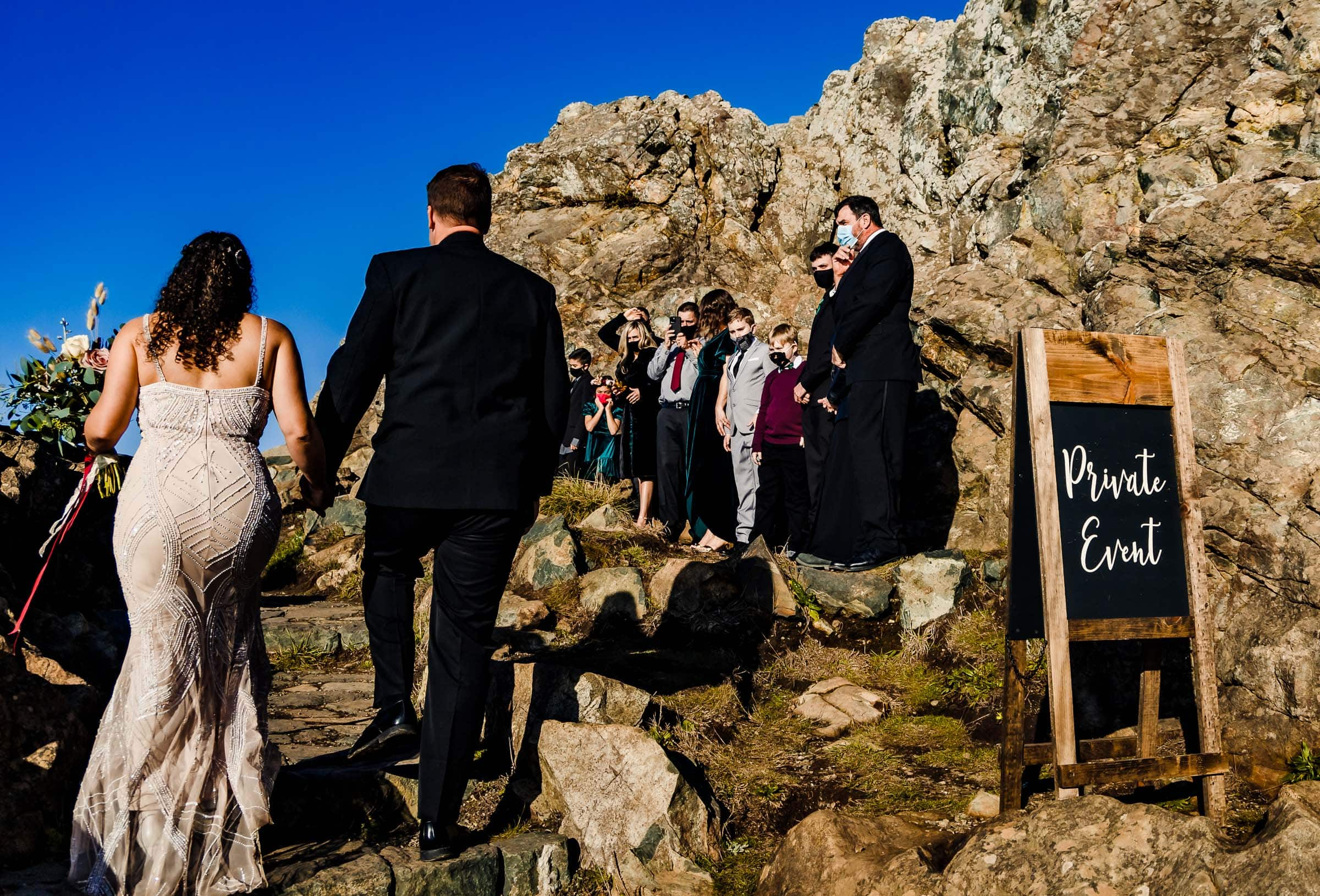 Bride and groom Bride walking into their Patricks Point elopement ceremony on Wedding Rock near Trinidad California