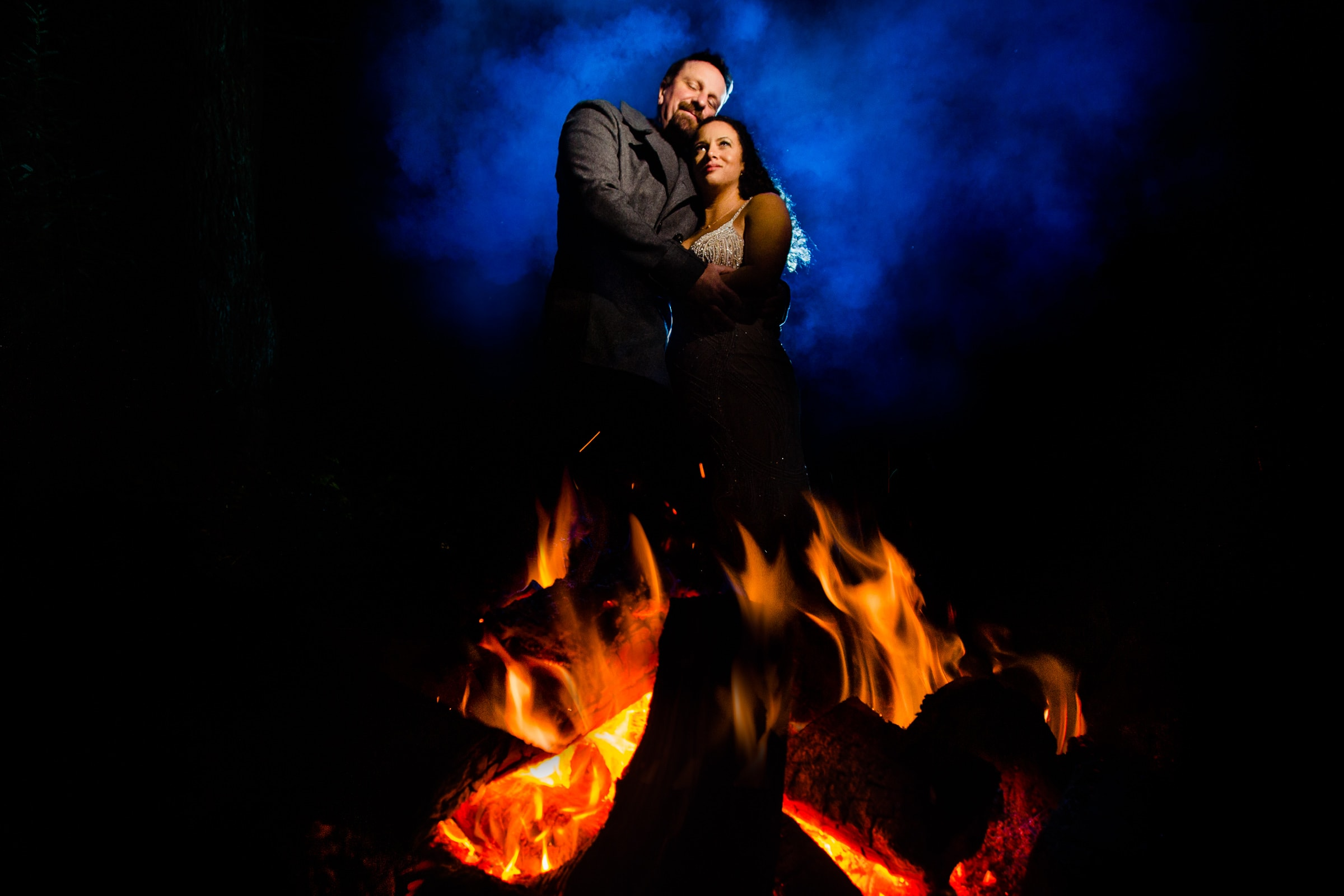 Bride and groom creative night portrait near a fire for their Patricks Point elopement on Wedding Rock near Trinidad California